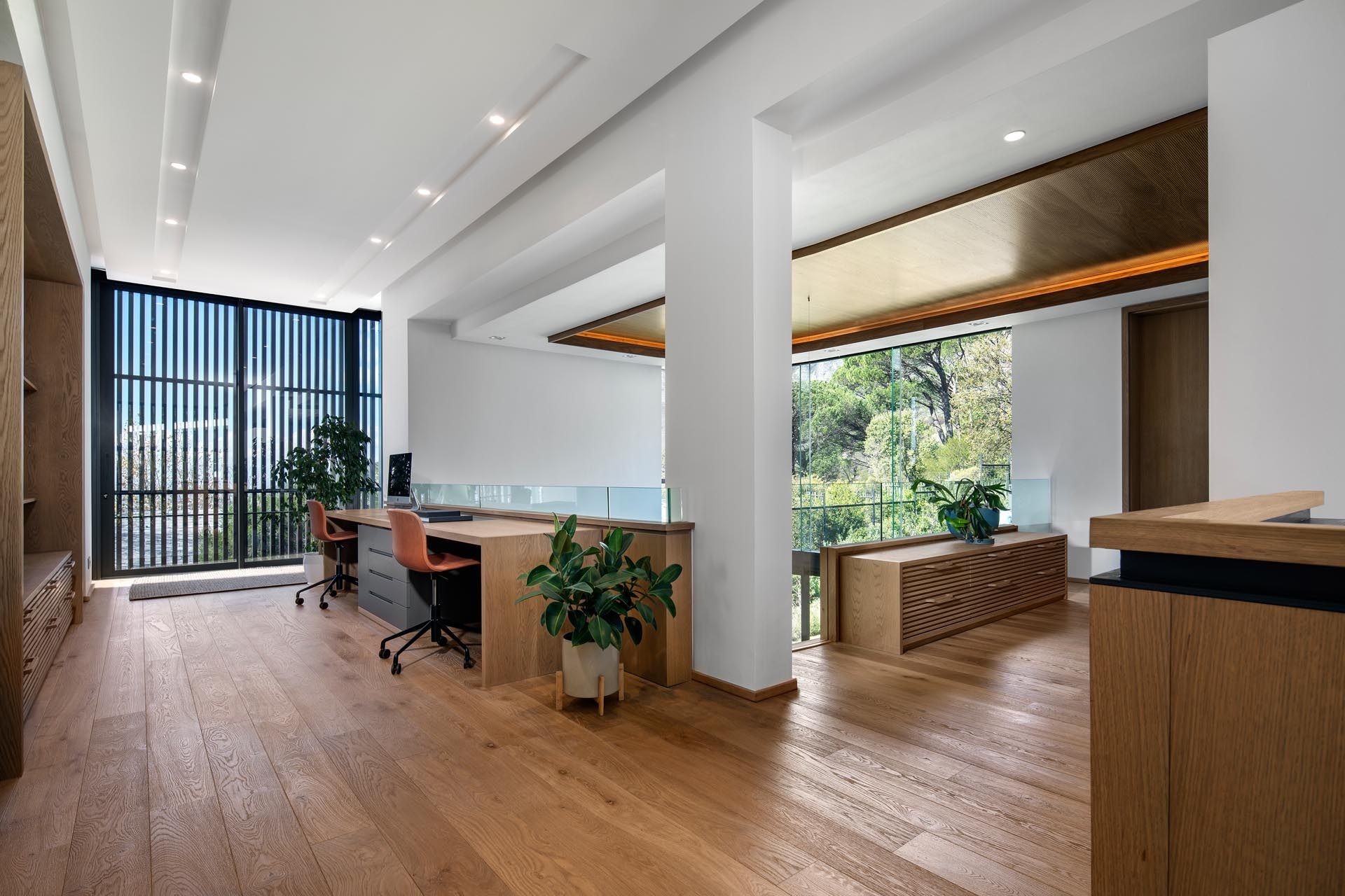 A modern home office with room for two people.