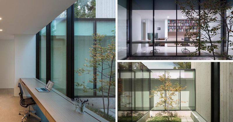 A Home Office Was Made Possible By Building A Desk Along A Wall Of Windows Inside This House