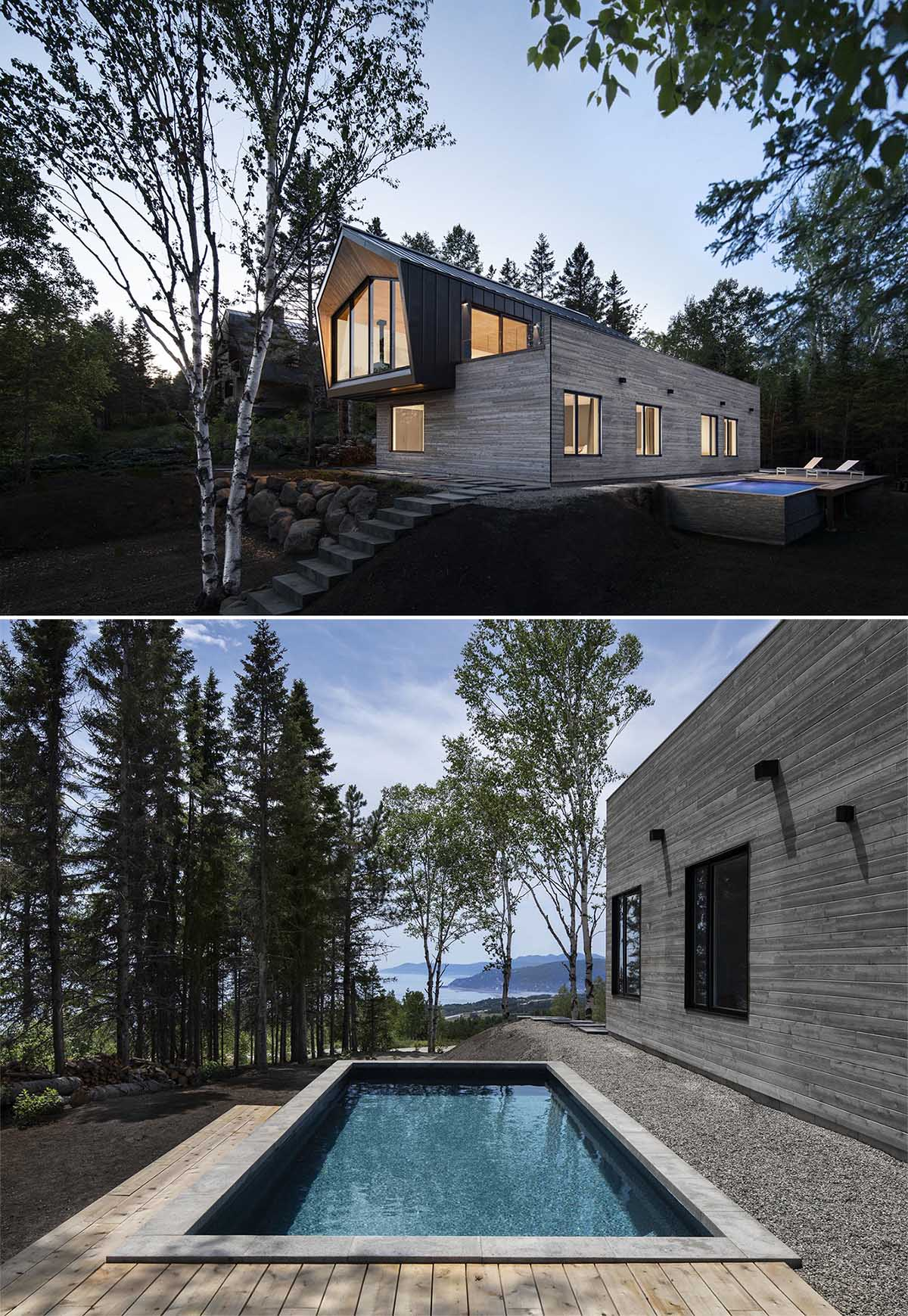 A modern home with a black metal and wood exterior, and a swimming pool.