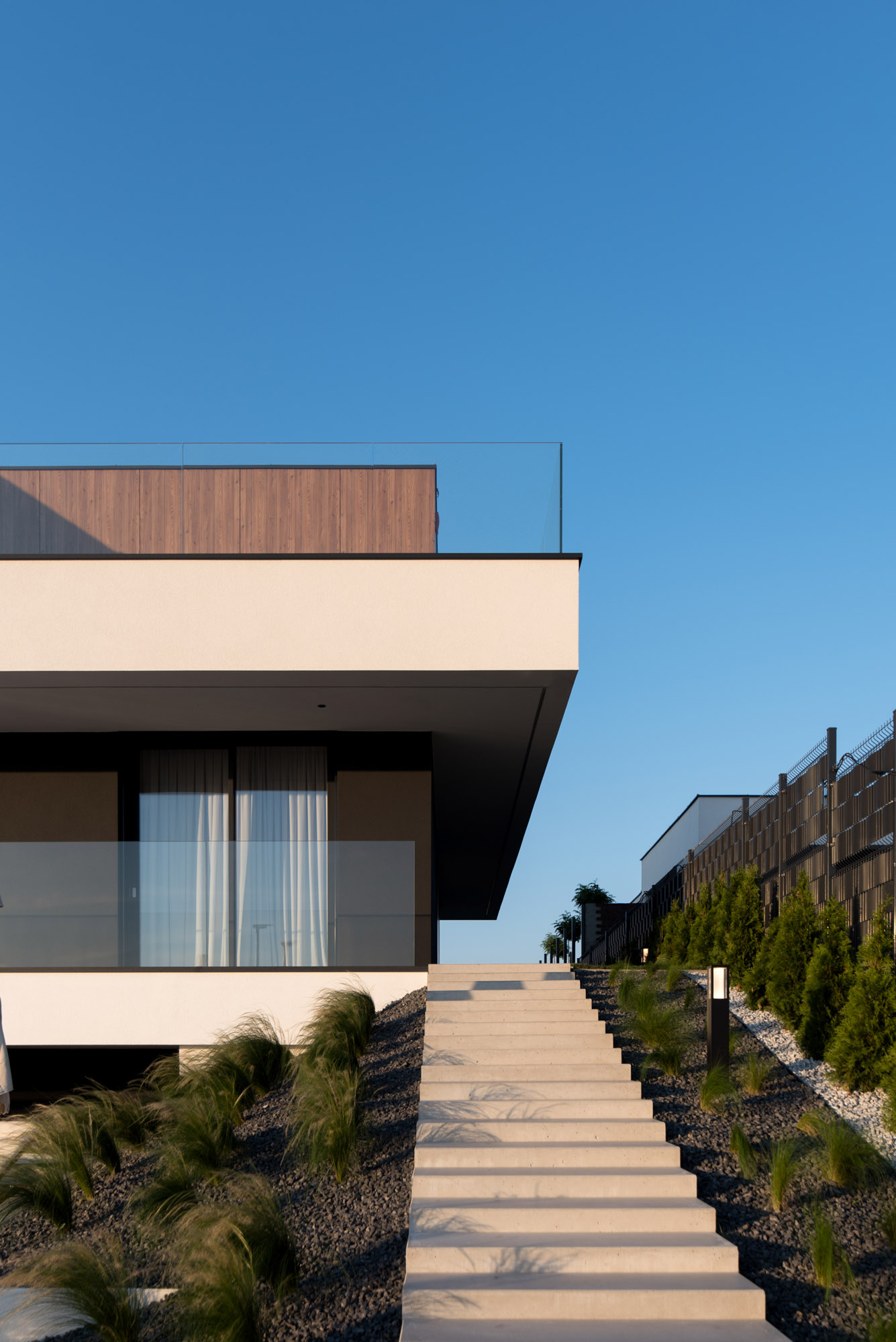 A modern house with exterior stairs.