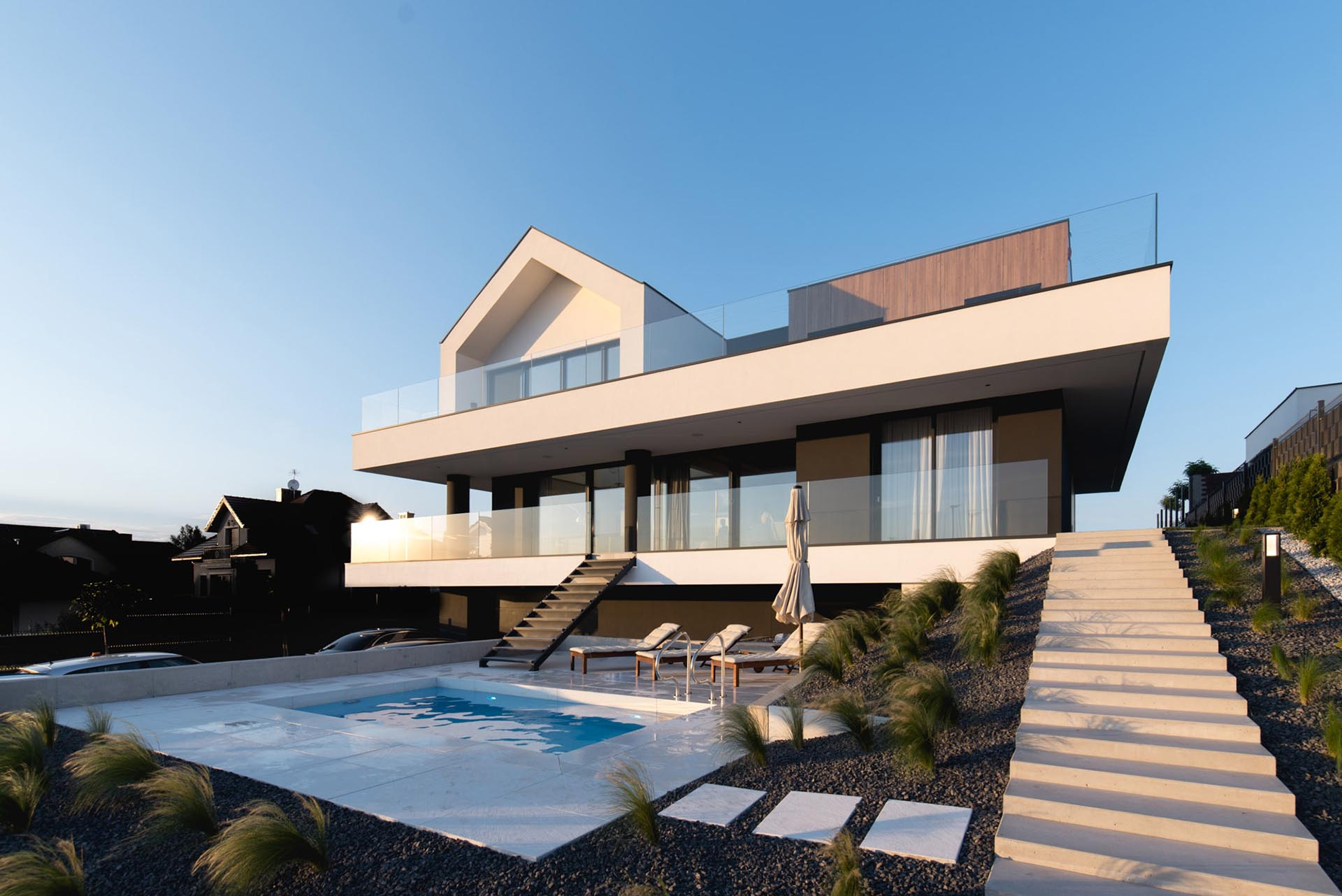 A modern home with a swimming pool and surrounding deck.