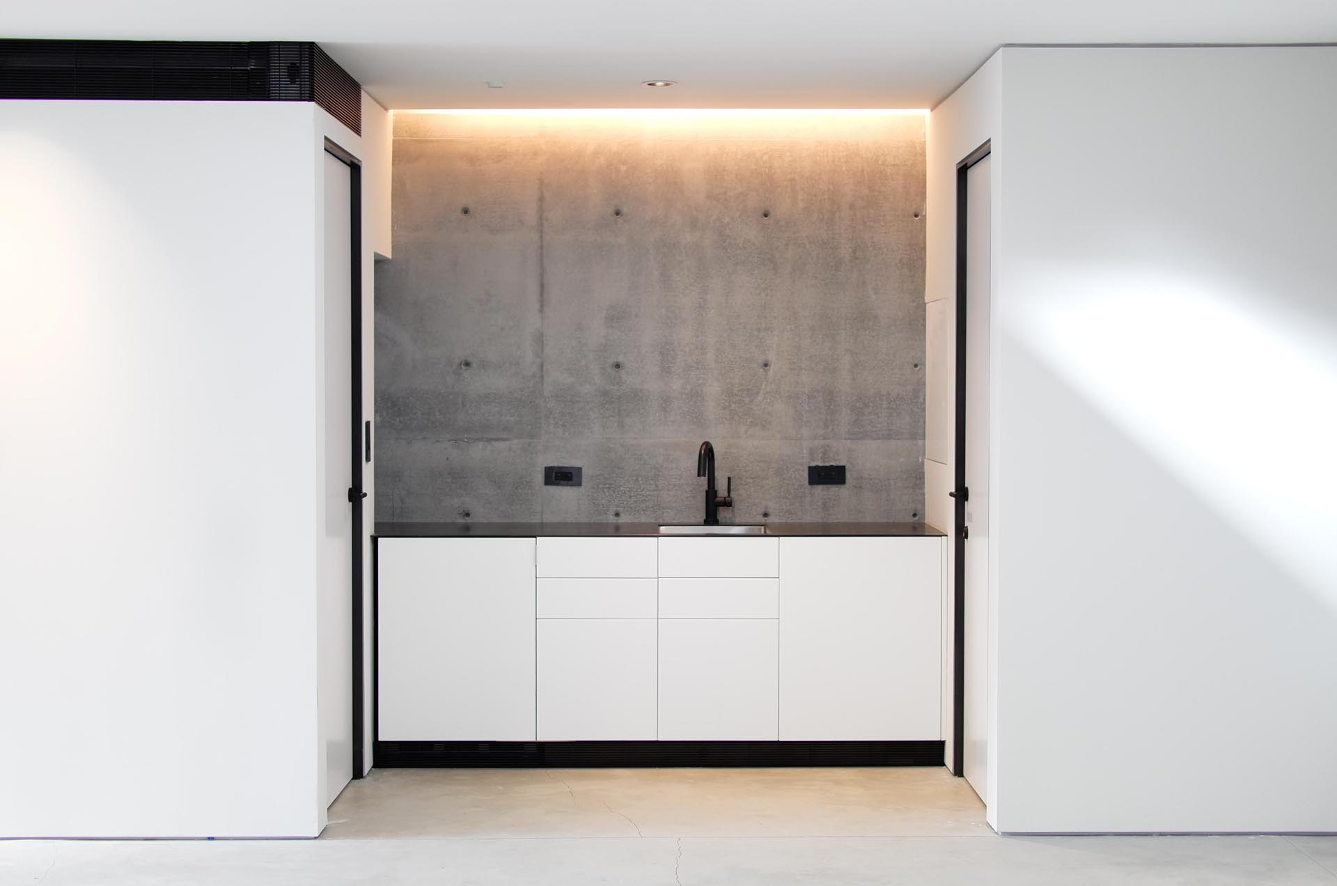 A built-in kitchenette highlighted by hidden lighting.