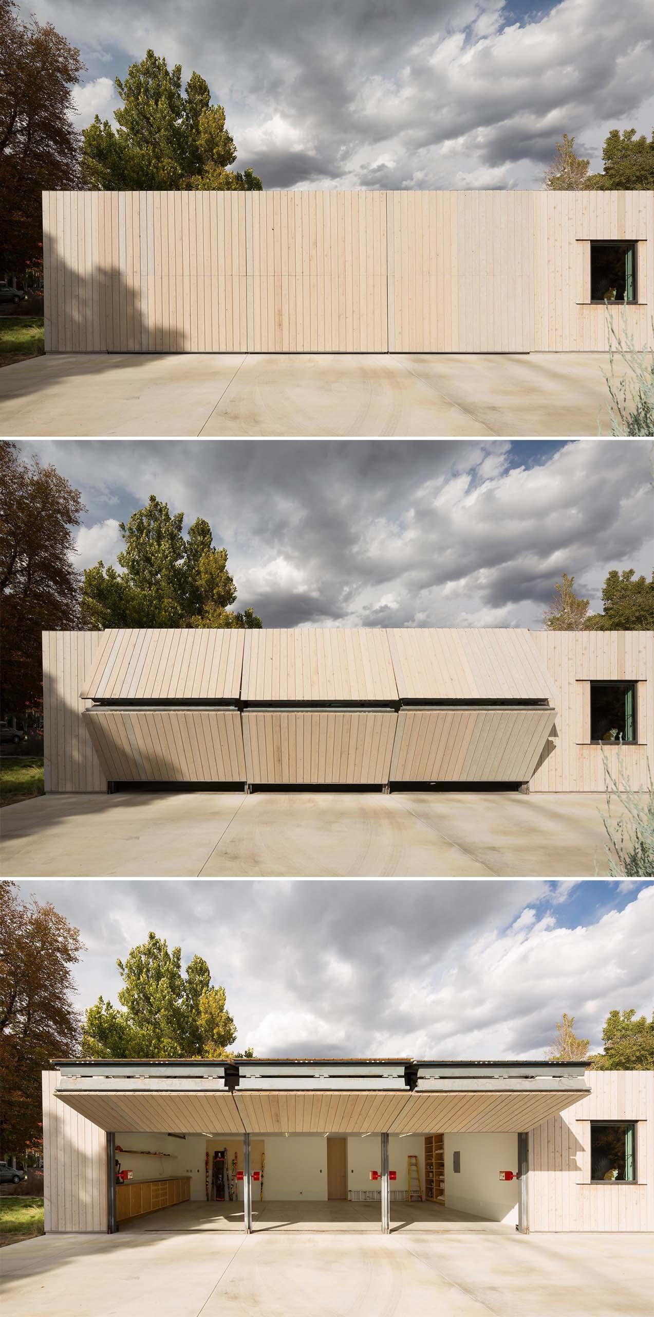 A modern cedar clad house with a matching garage that has hidden doors.