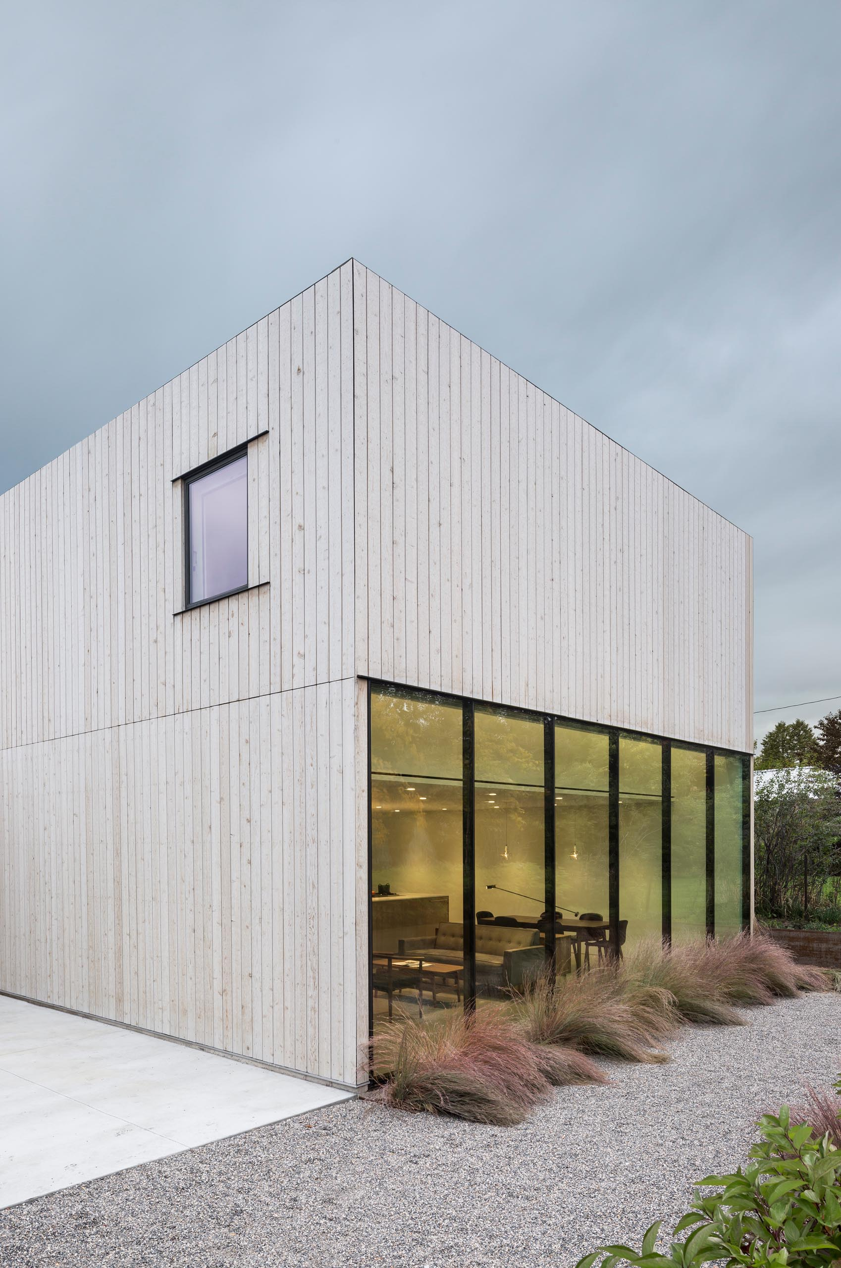 A modern cedar clad home with walls of glass.