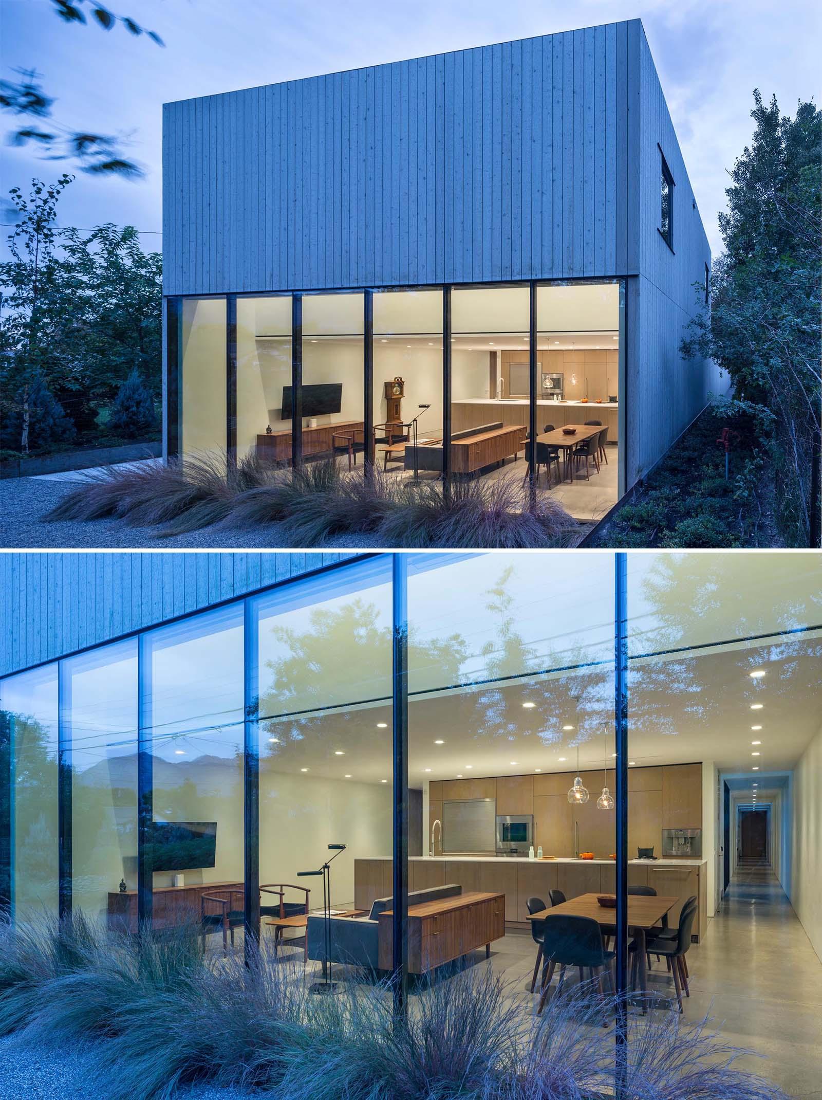 A modern cedar clad home with a glass wall.