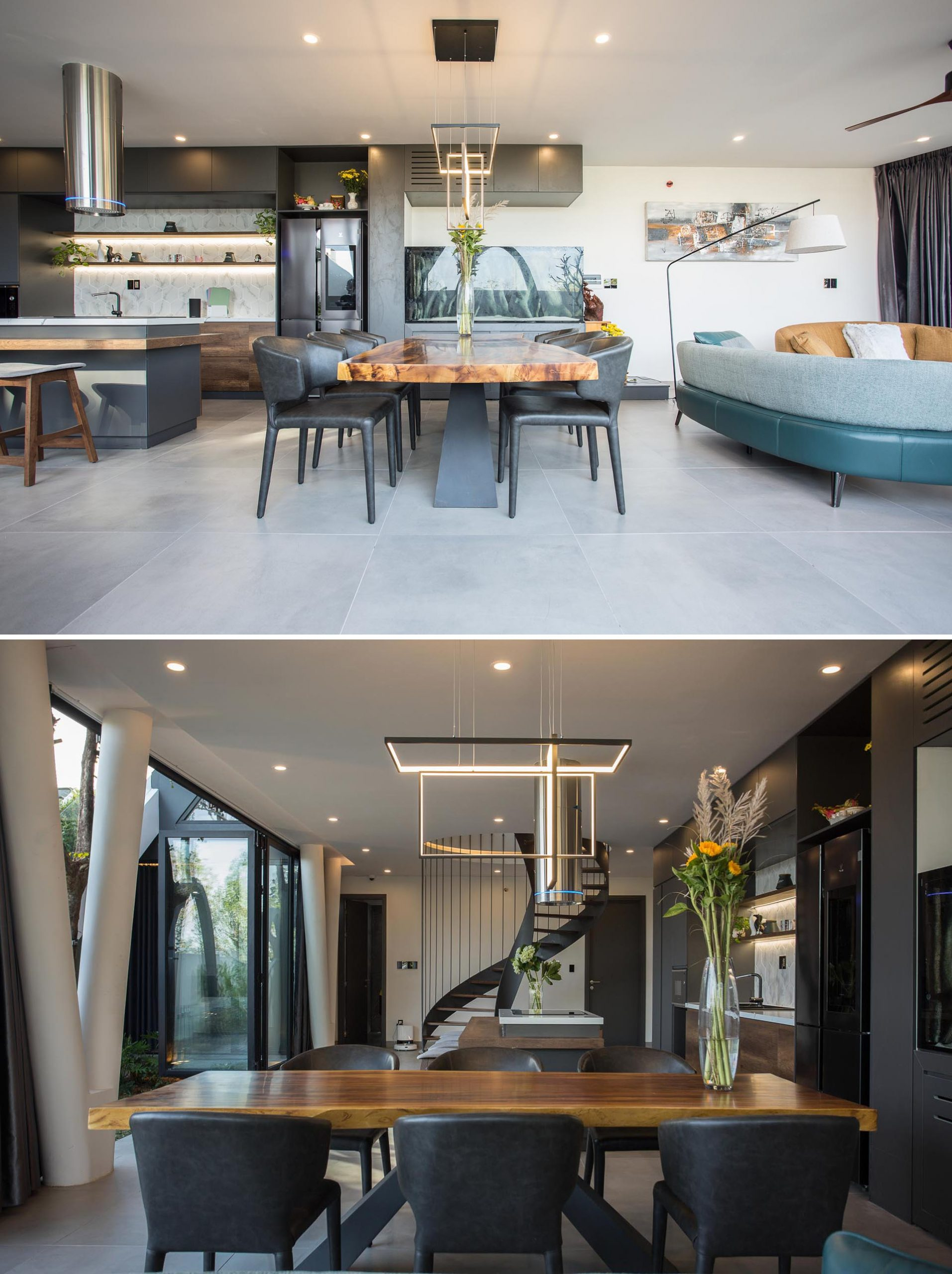 The dining room of this modern home is furnished with a wood top dining table and black chairs, and separates the living room and the kitchen.