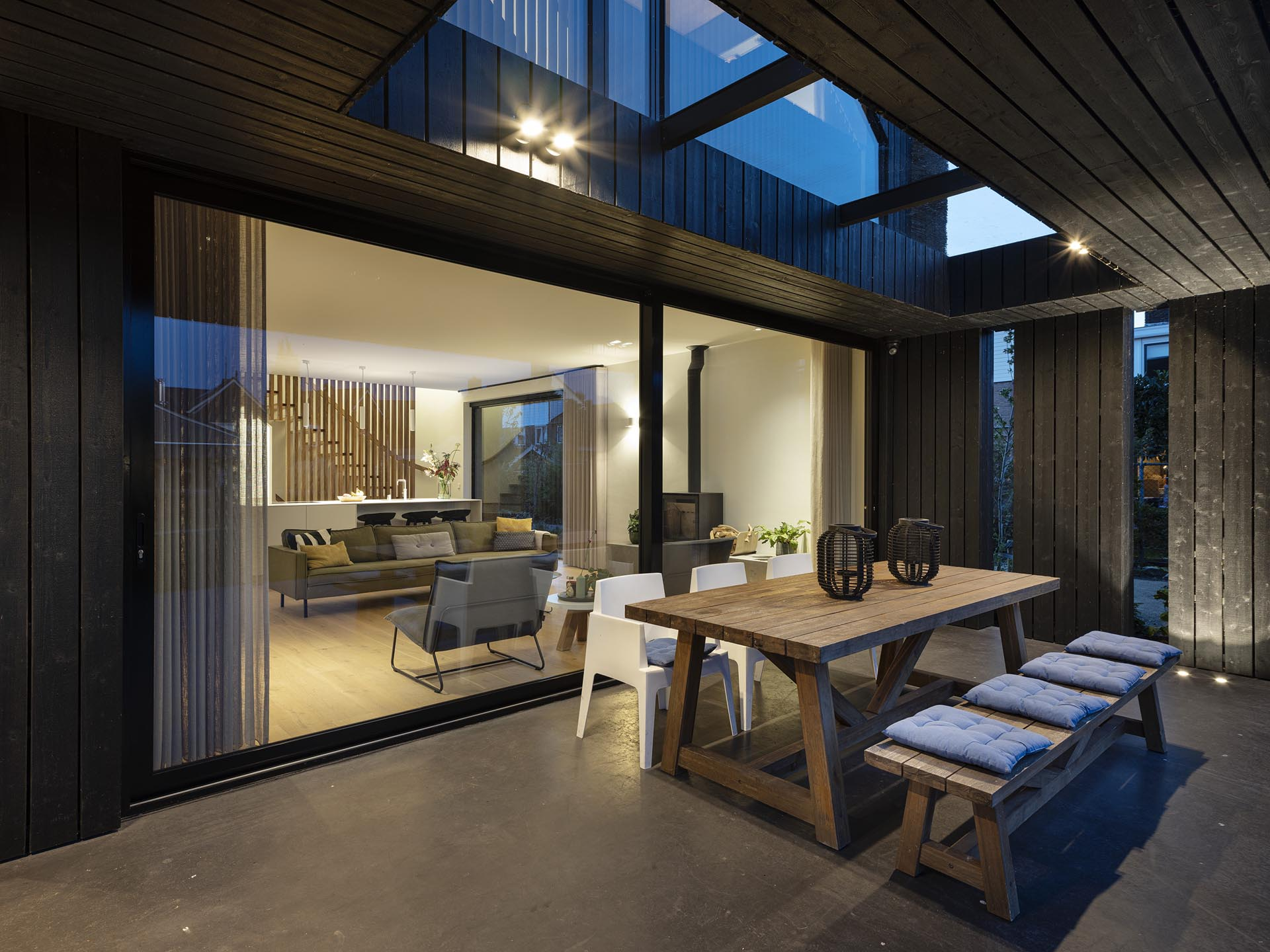 A modern home with an outdoor dining patio.