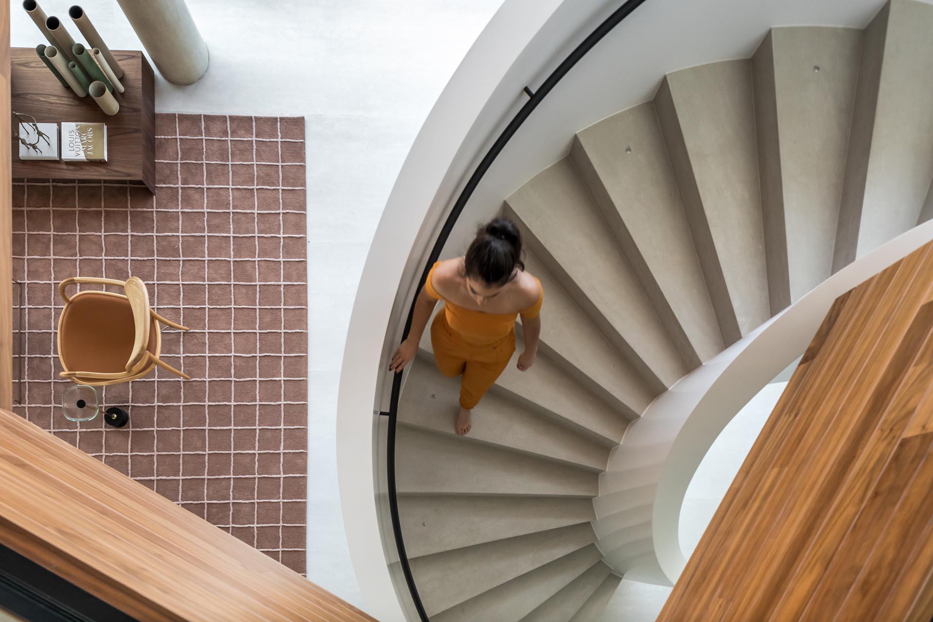 Modern white spiral staircase.