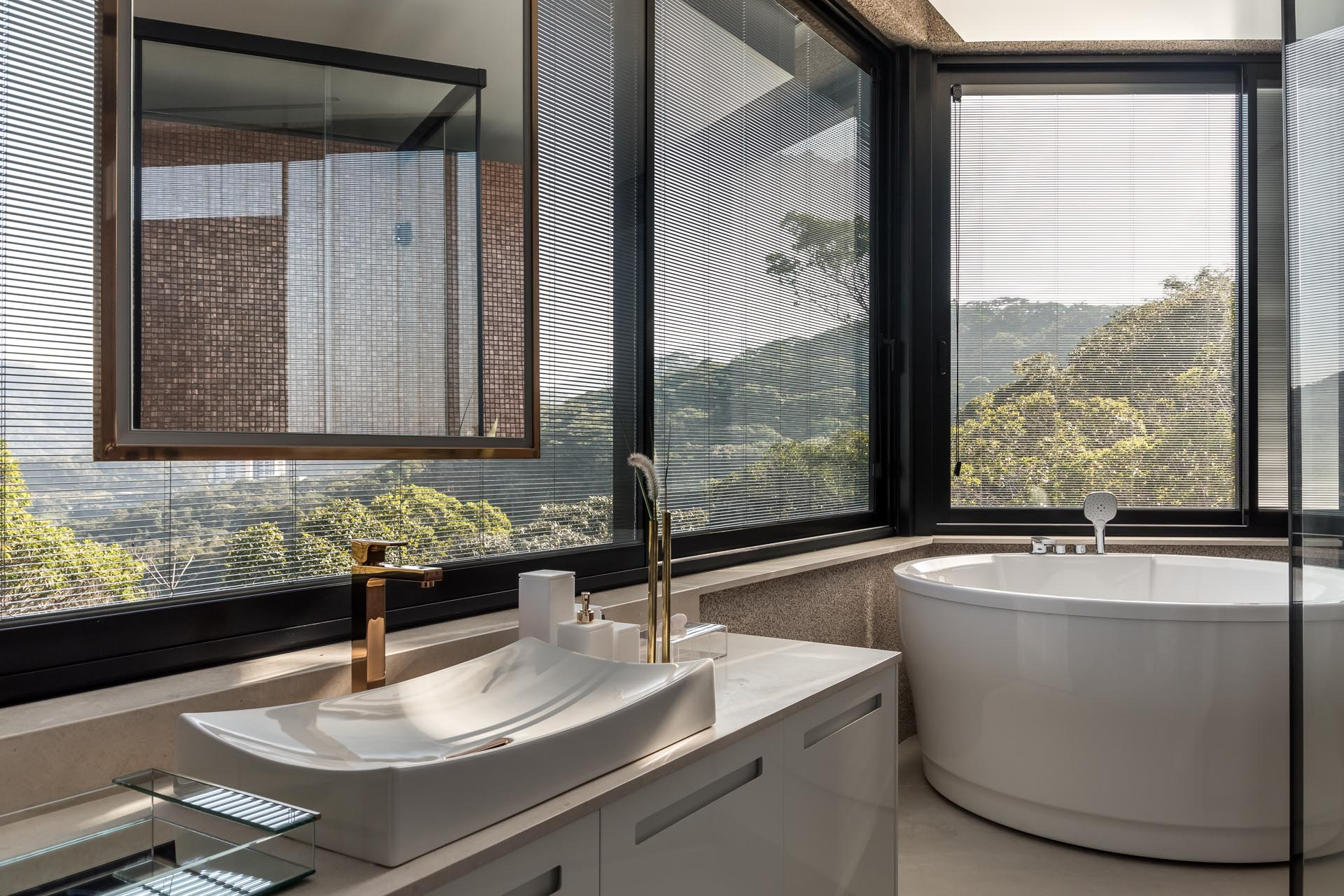 This bathroom has plenty of windows to maximize the views for the deep soaking tub and vanity area.