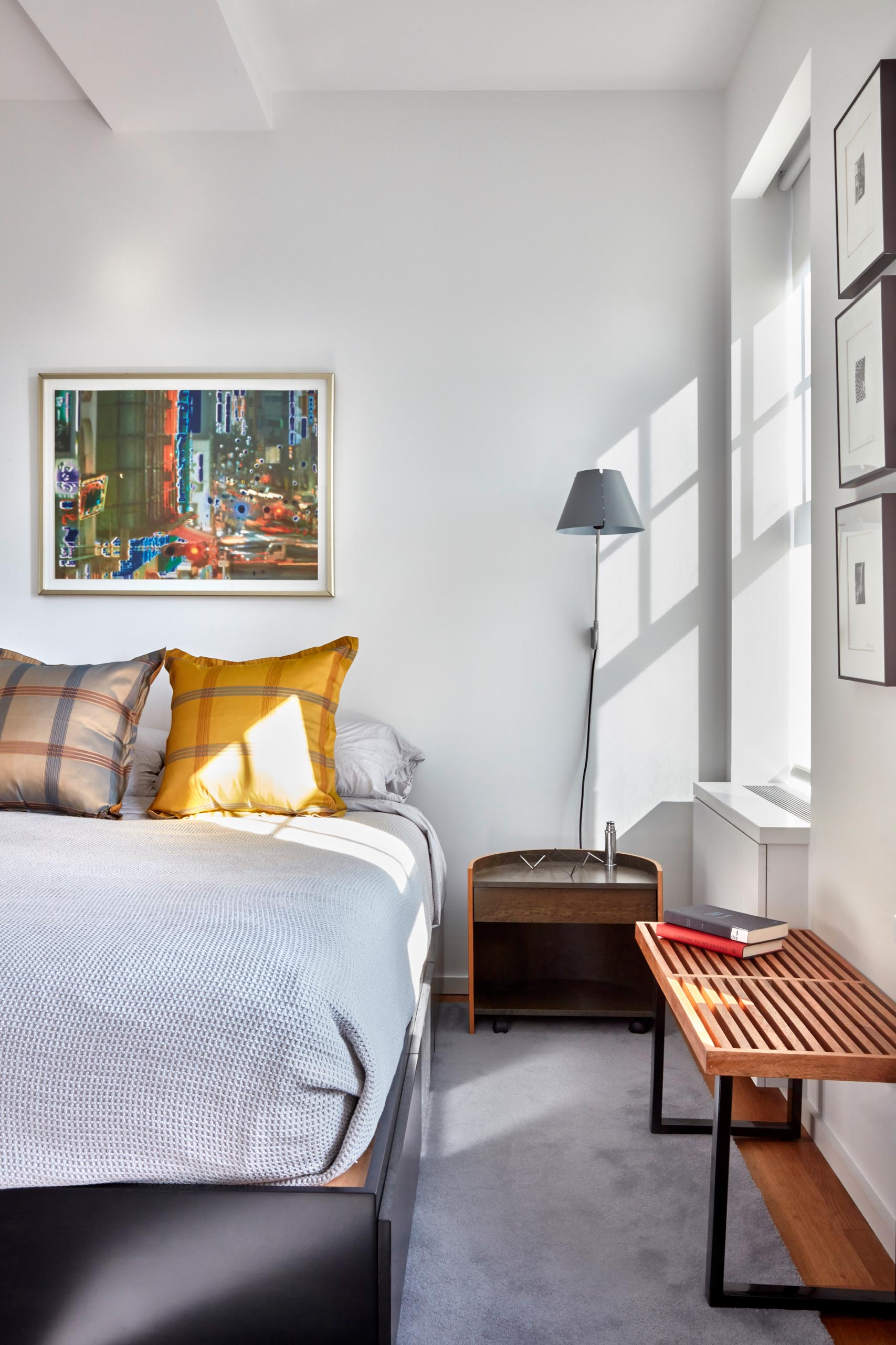 A bright and contemporary bedroom with minimal furniture.