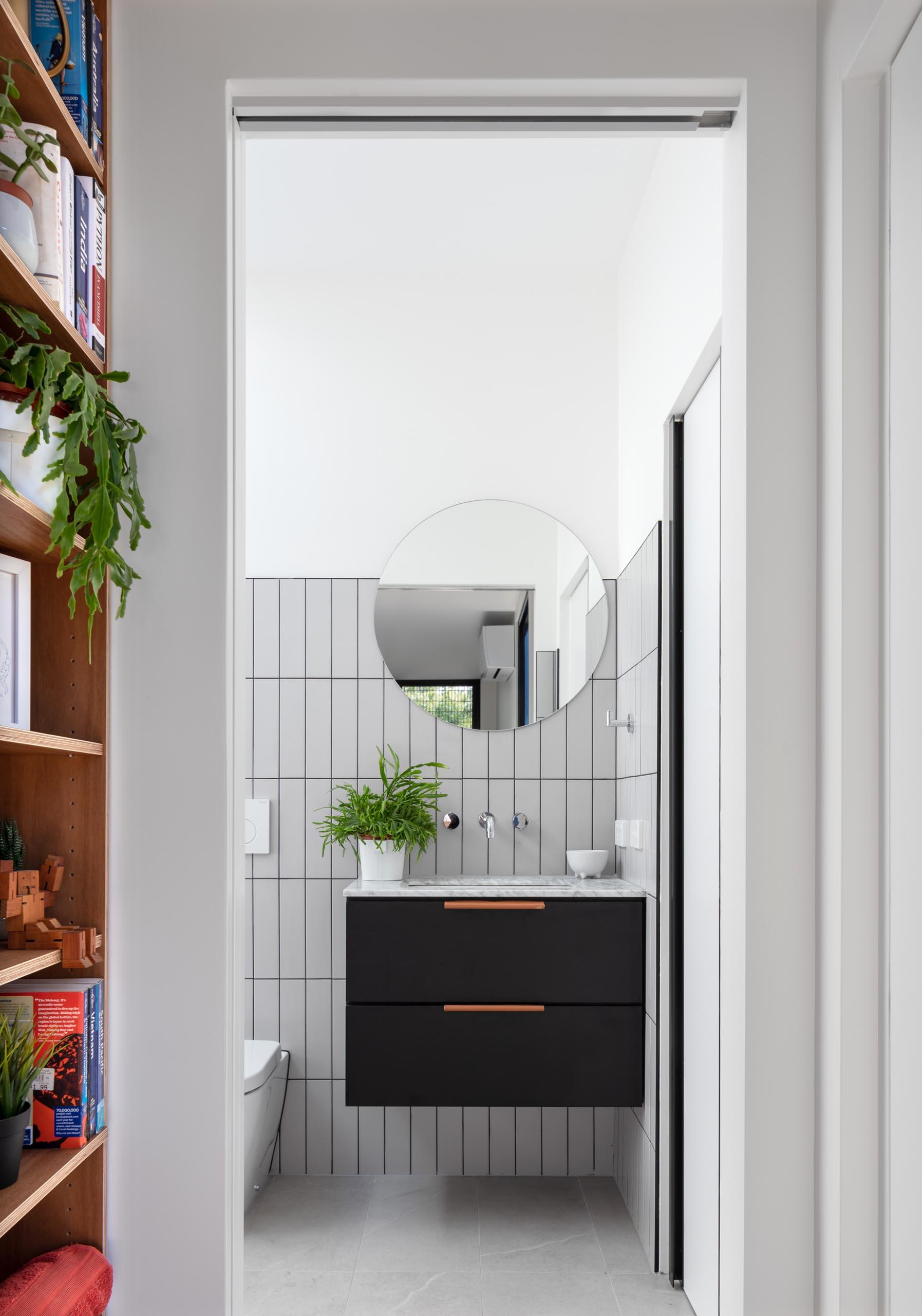 A modern grey, white, and black bathroom.