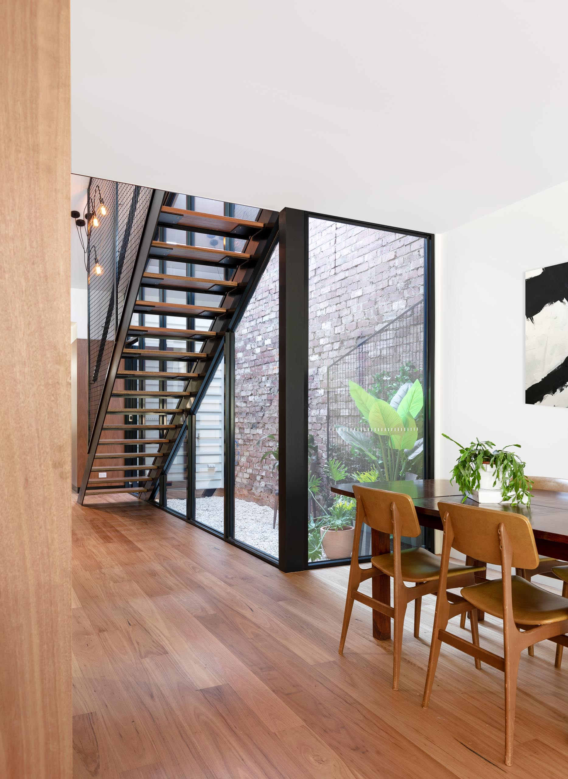 A modern home with a small outdoor courtyard and blackbutt wood flooring.