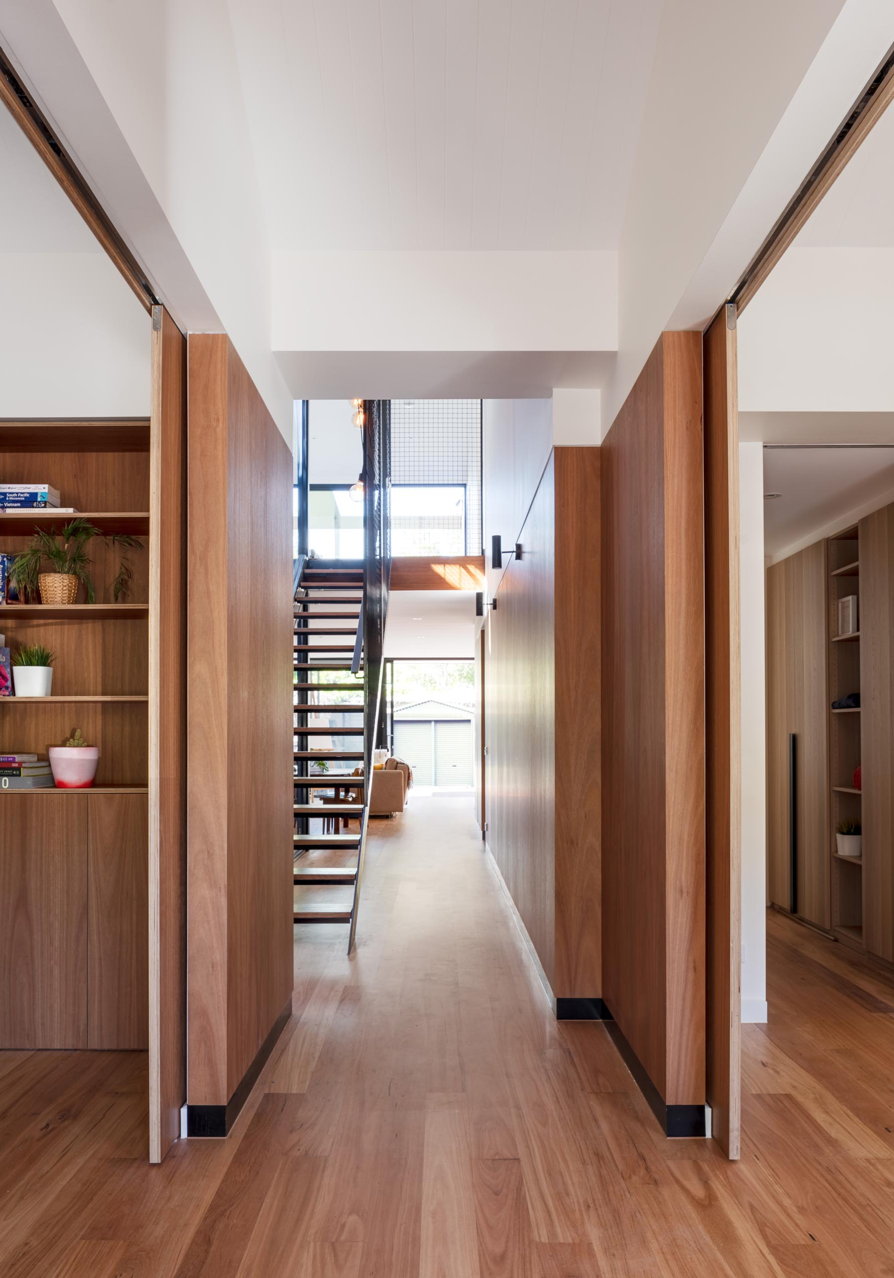 Blackbutt flooring is used throughout adding a warmth to this modern home interiors.