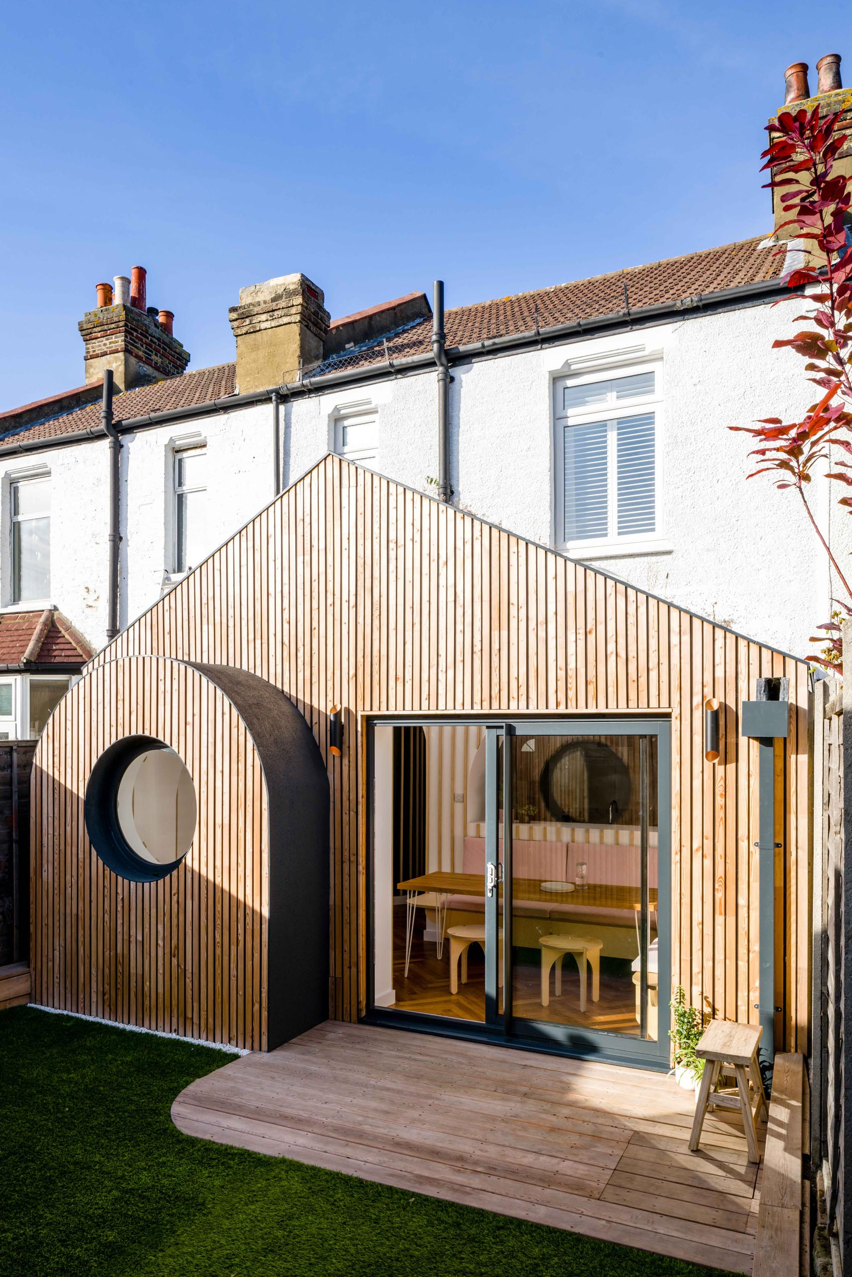 This modern house addition features tongue-and-groove larch cladding.