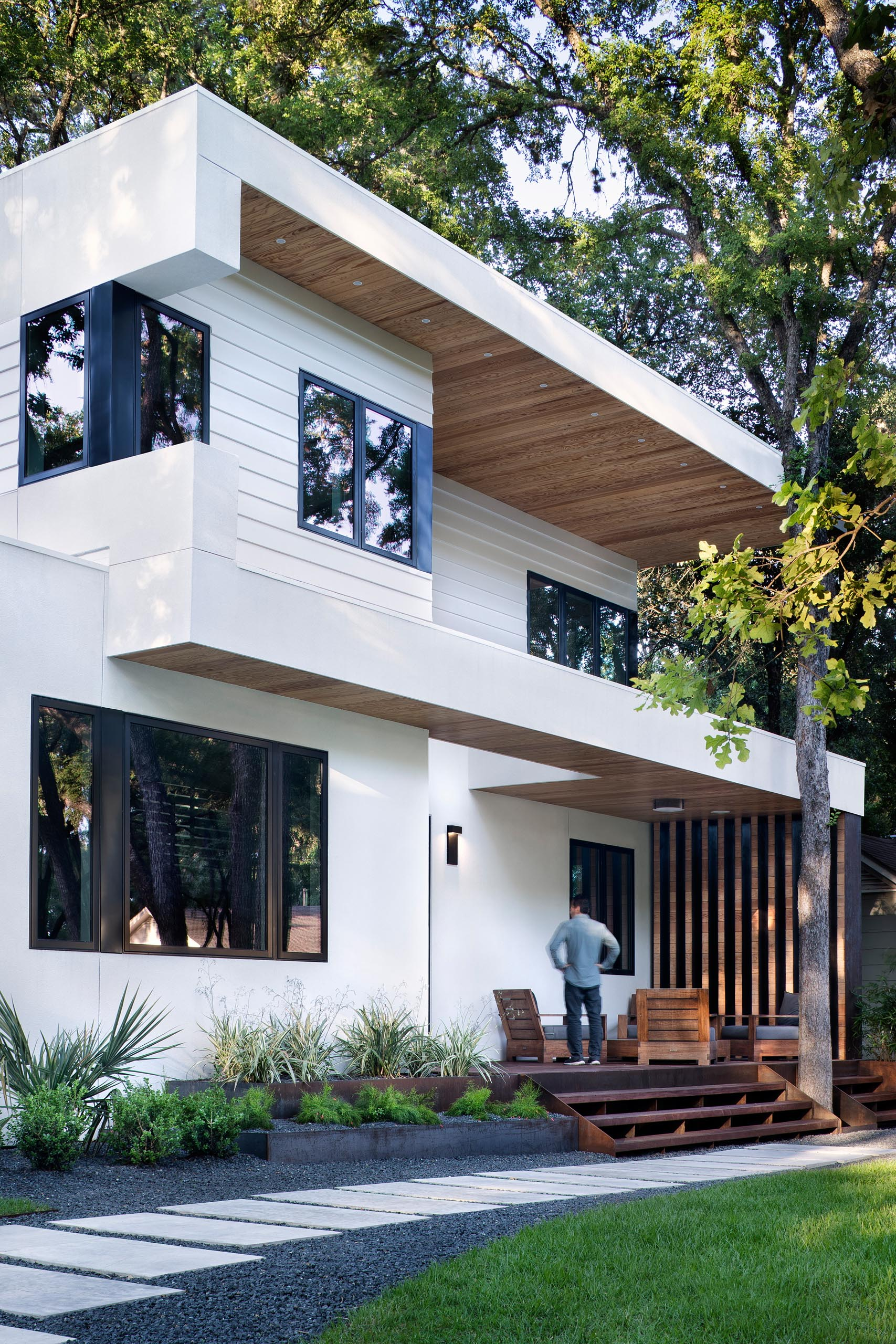 A modern white house with a front porch.