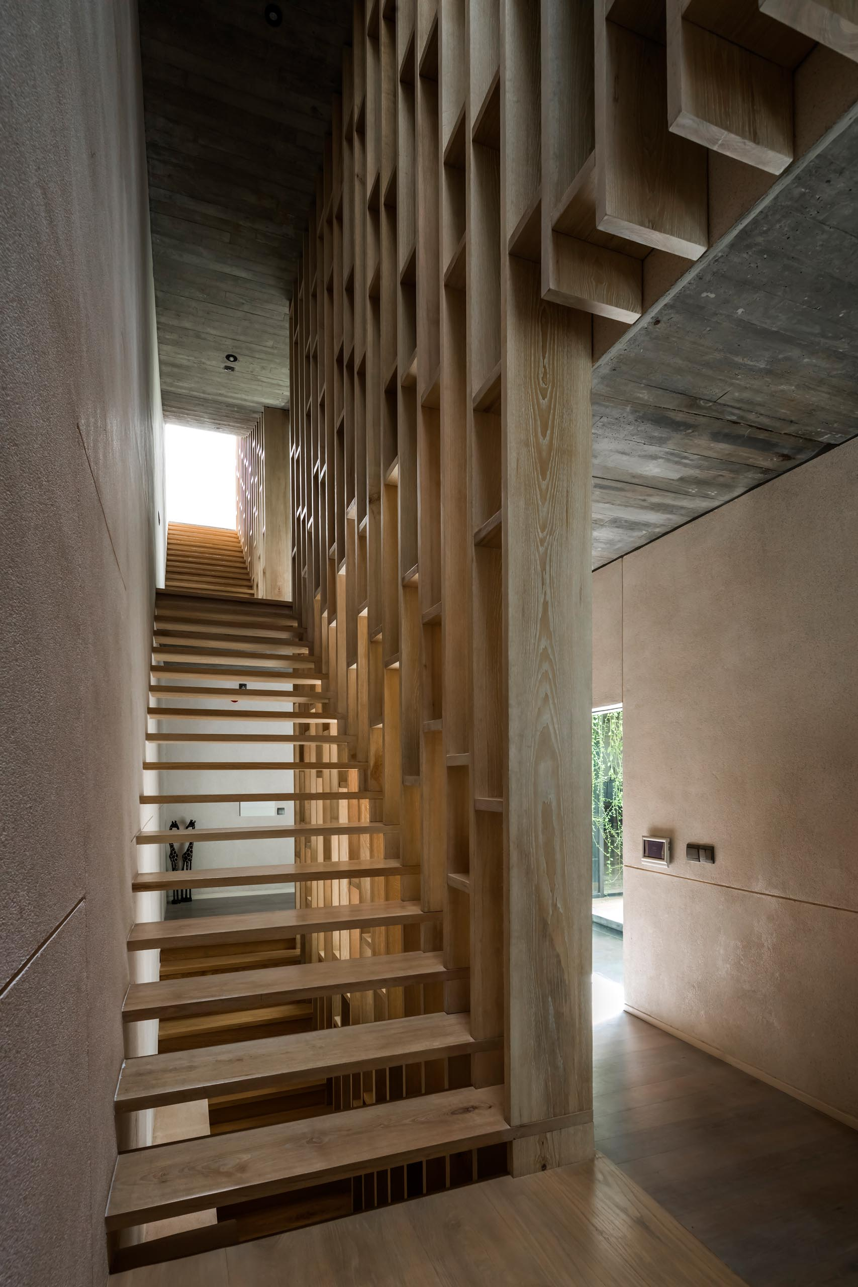 Modern wood stairs with shelves.
