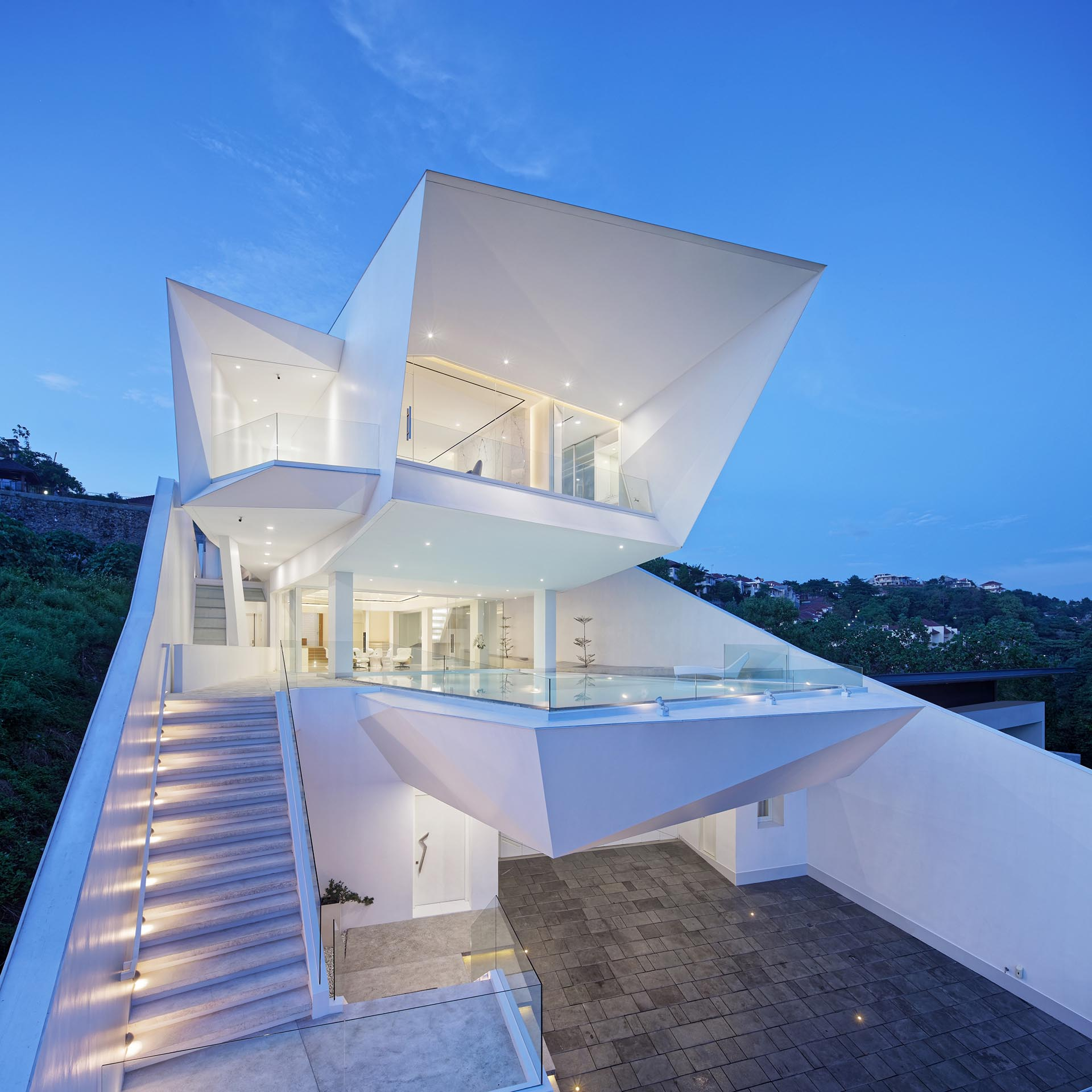 A modern all-white house designed by Revano Satria.