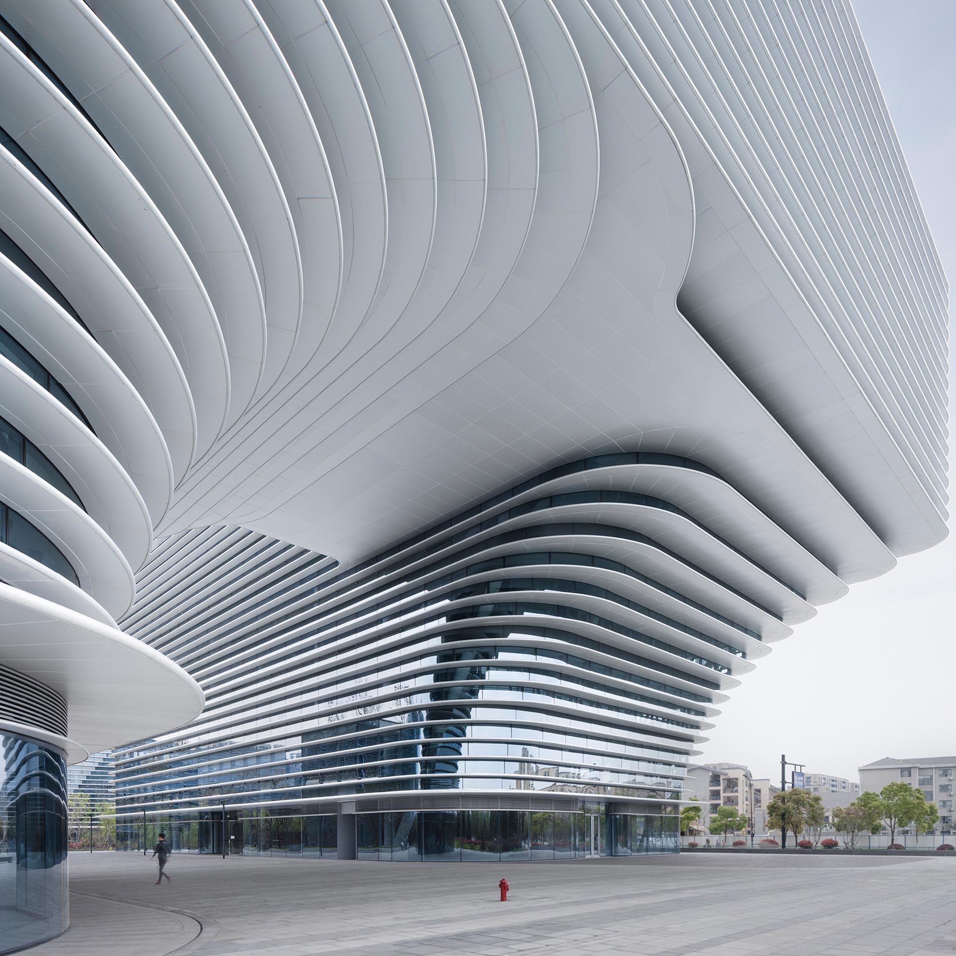 A modern white building named 'Cloud Park', designed by Meng Fanhao.