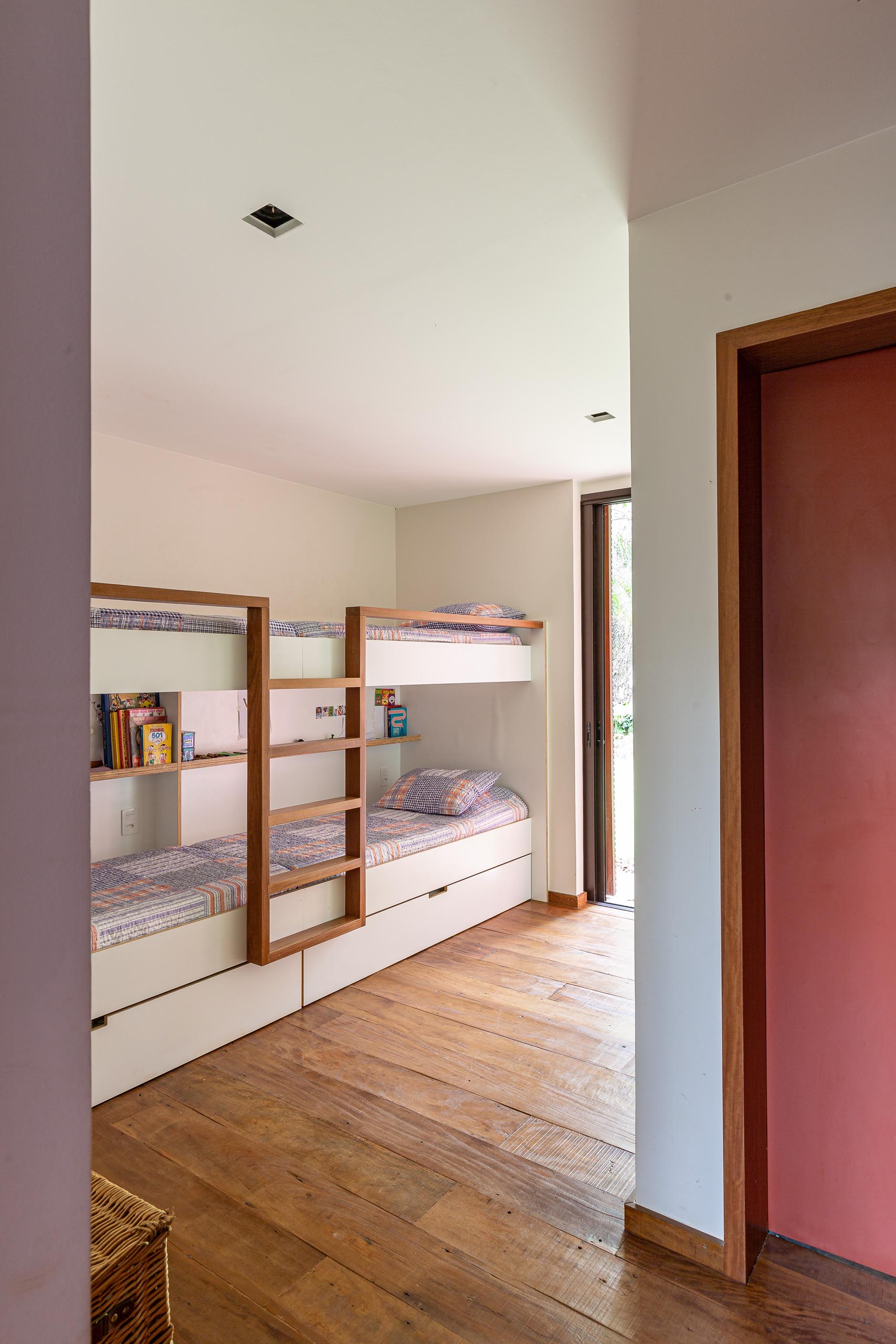 In this modern bedroom there's custom-built bunk beds, allowing for multiple people to sleep in the one room.