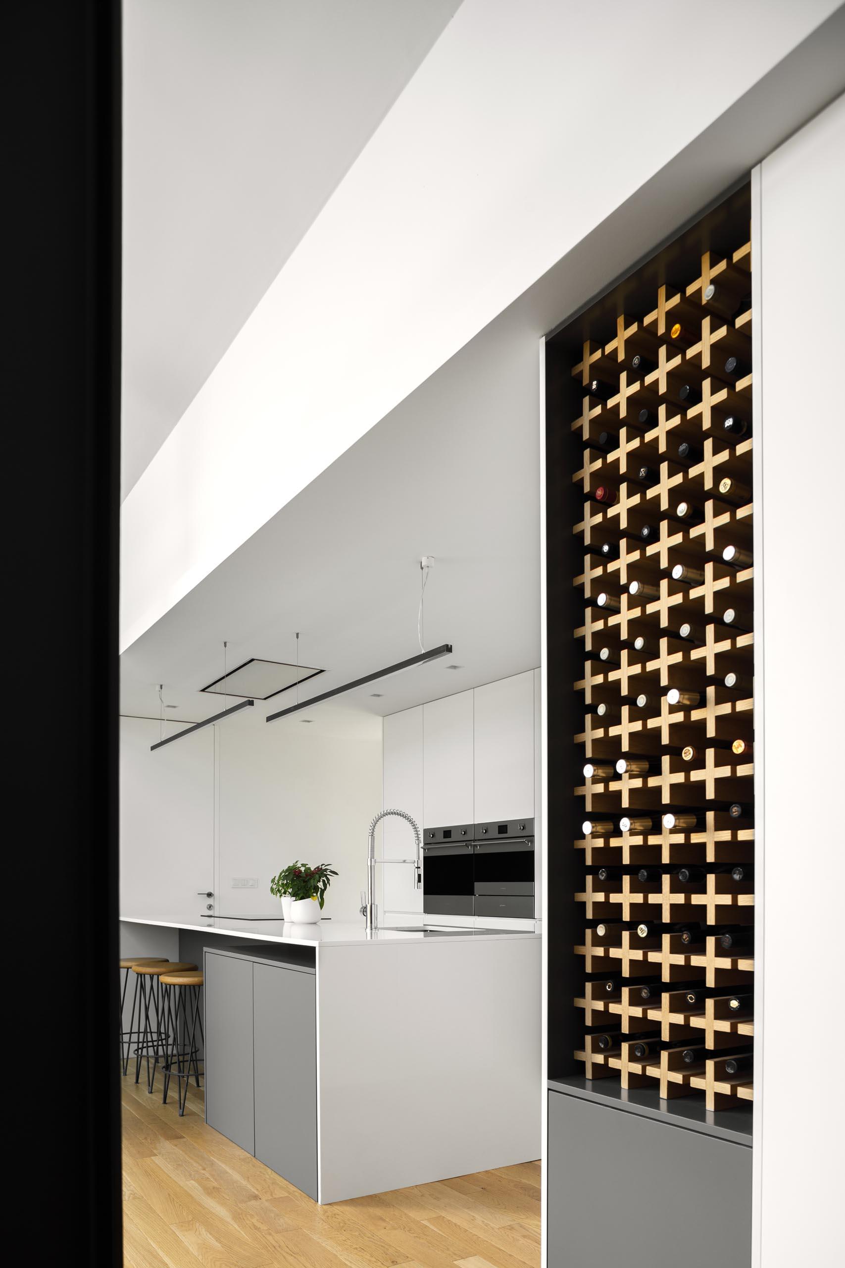 A modern kitchen with built-in wine storage.