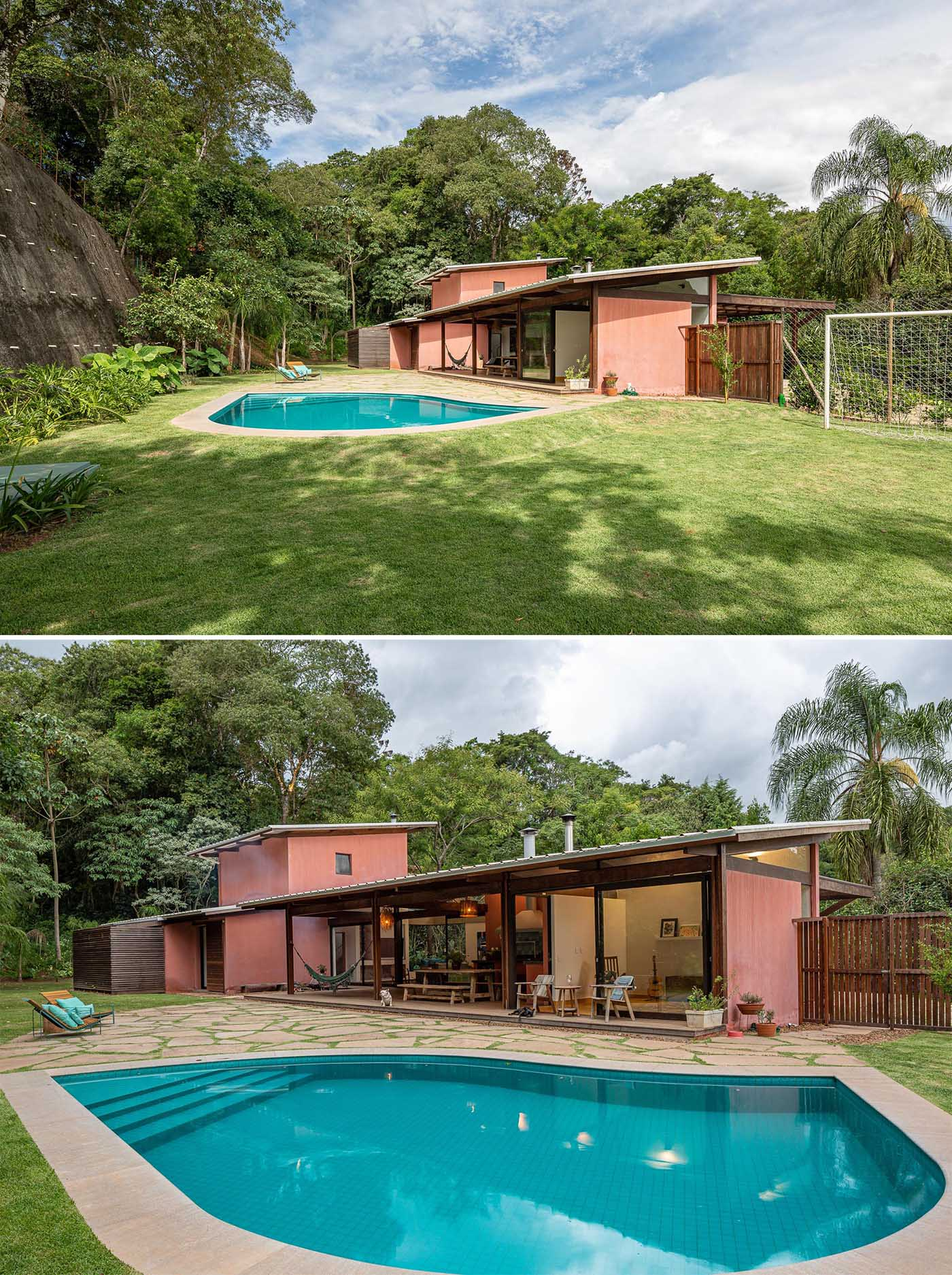 This contemporary home has a sloped roof, large yard, and swimming pool.