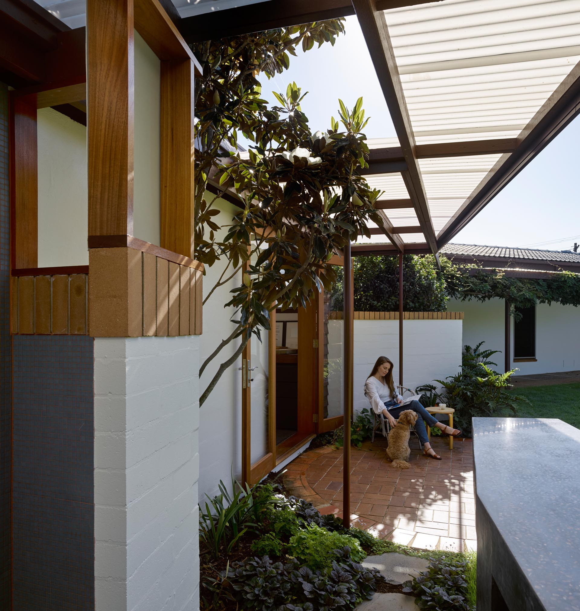 A converted carport with a brick patio.