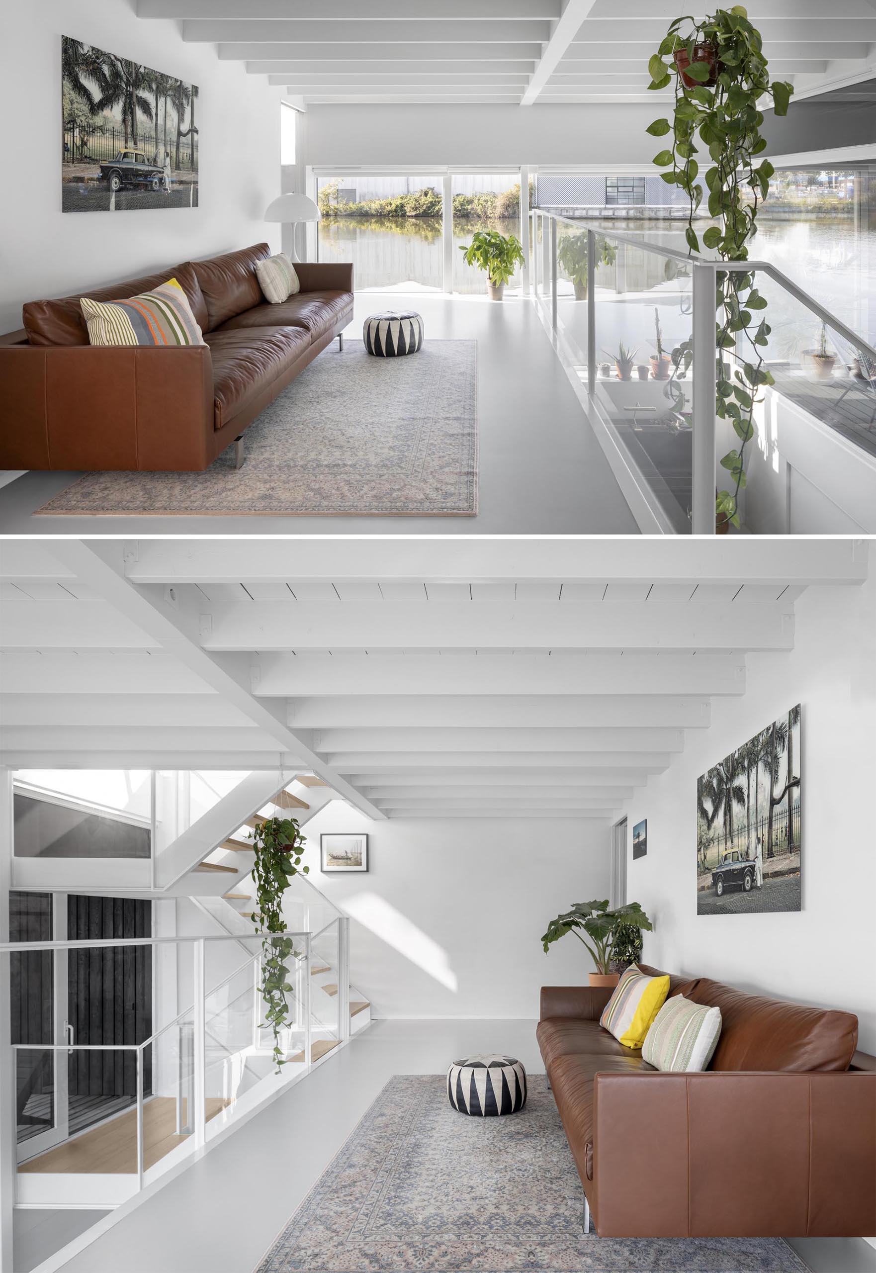 A modern float home with white walls, and a minimally furnished living room.