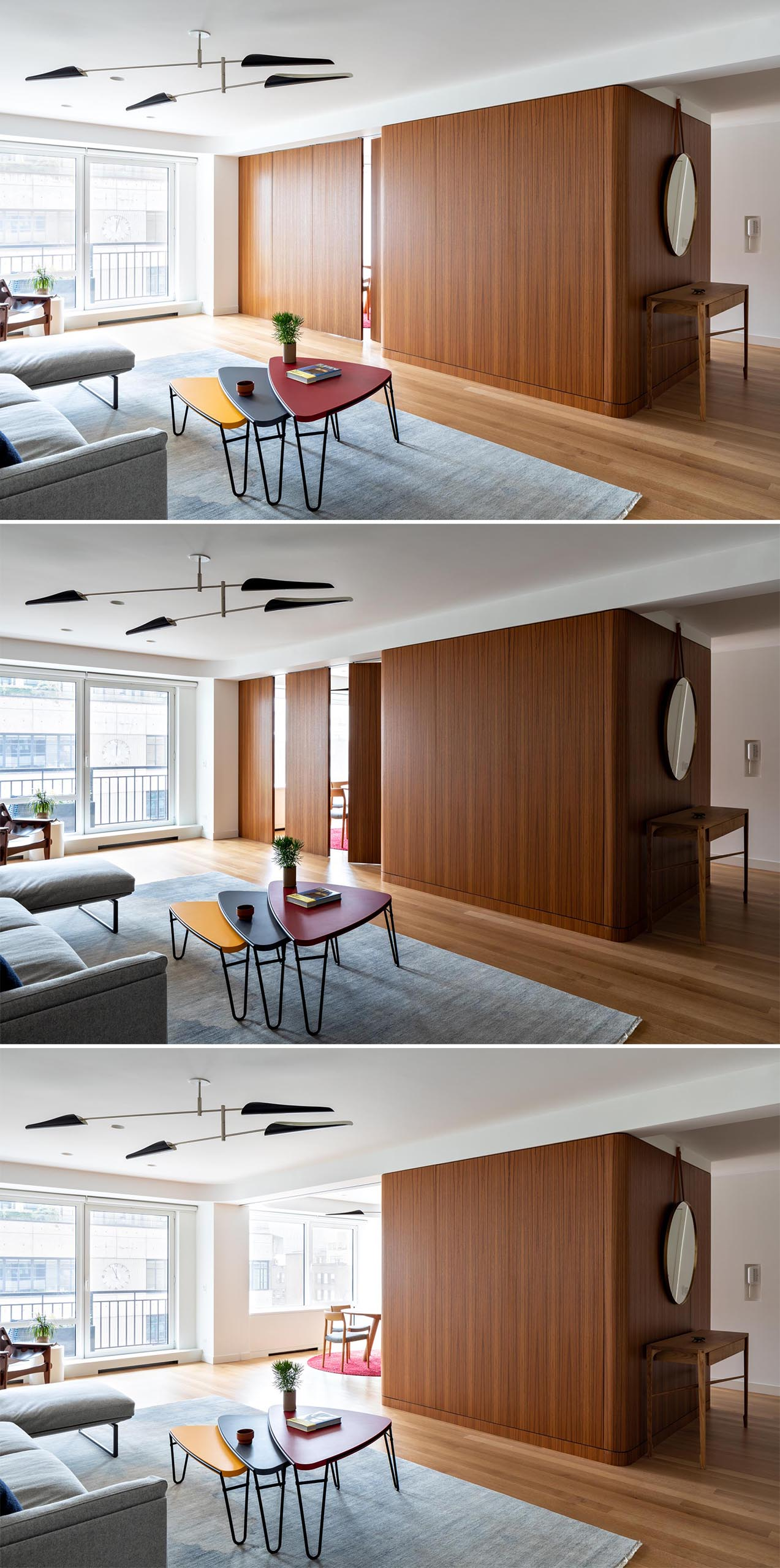 A teak wood wall that has pivoting panels that open to reveal the dining room.