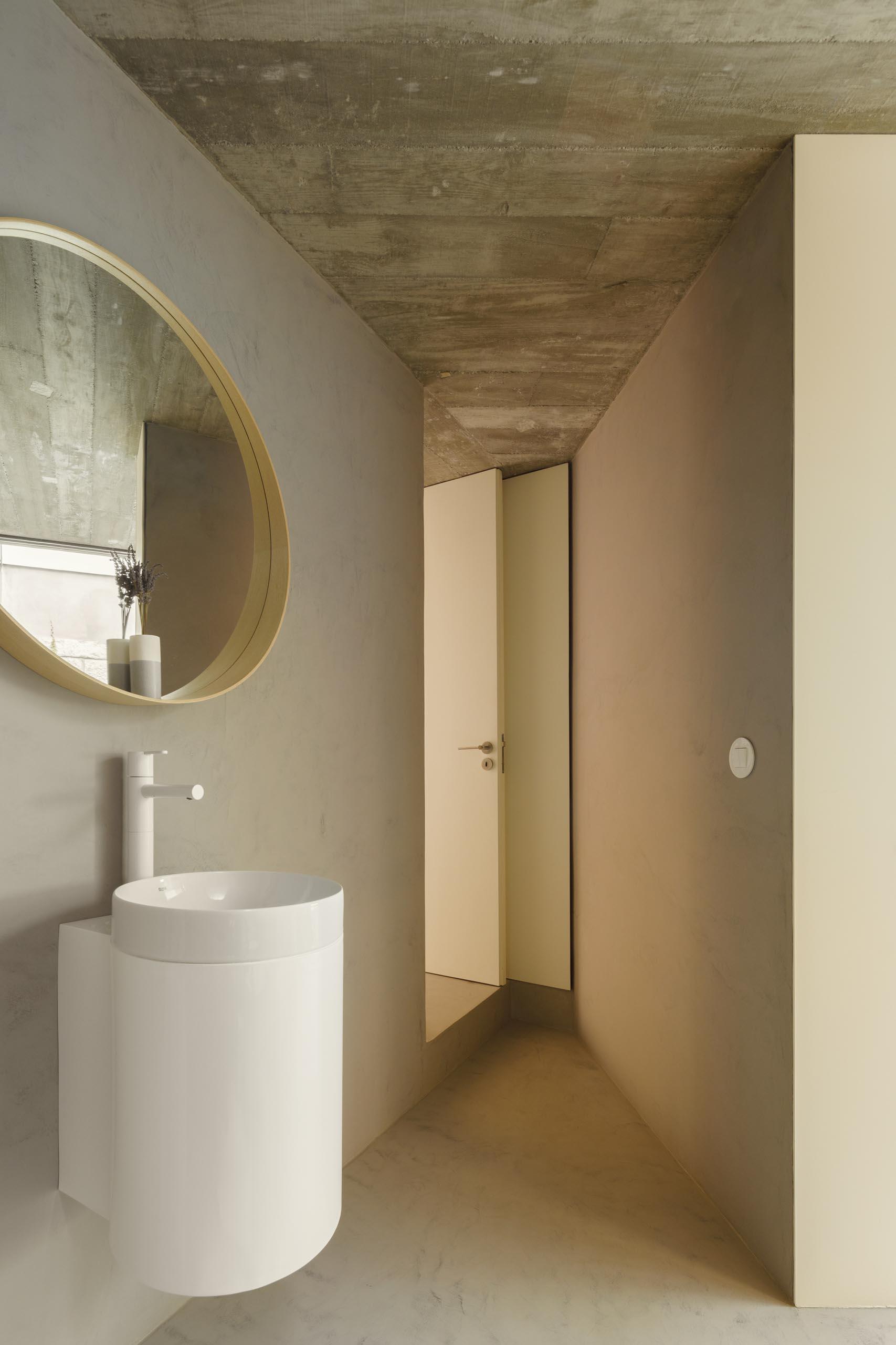 A modern bathroom with a minimalist vanity.
