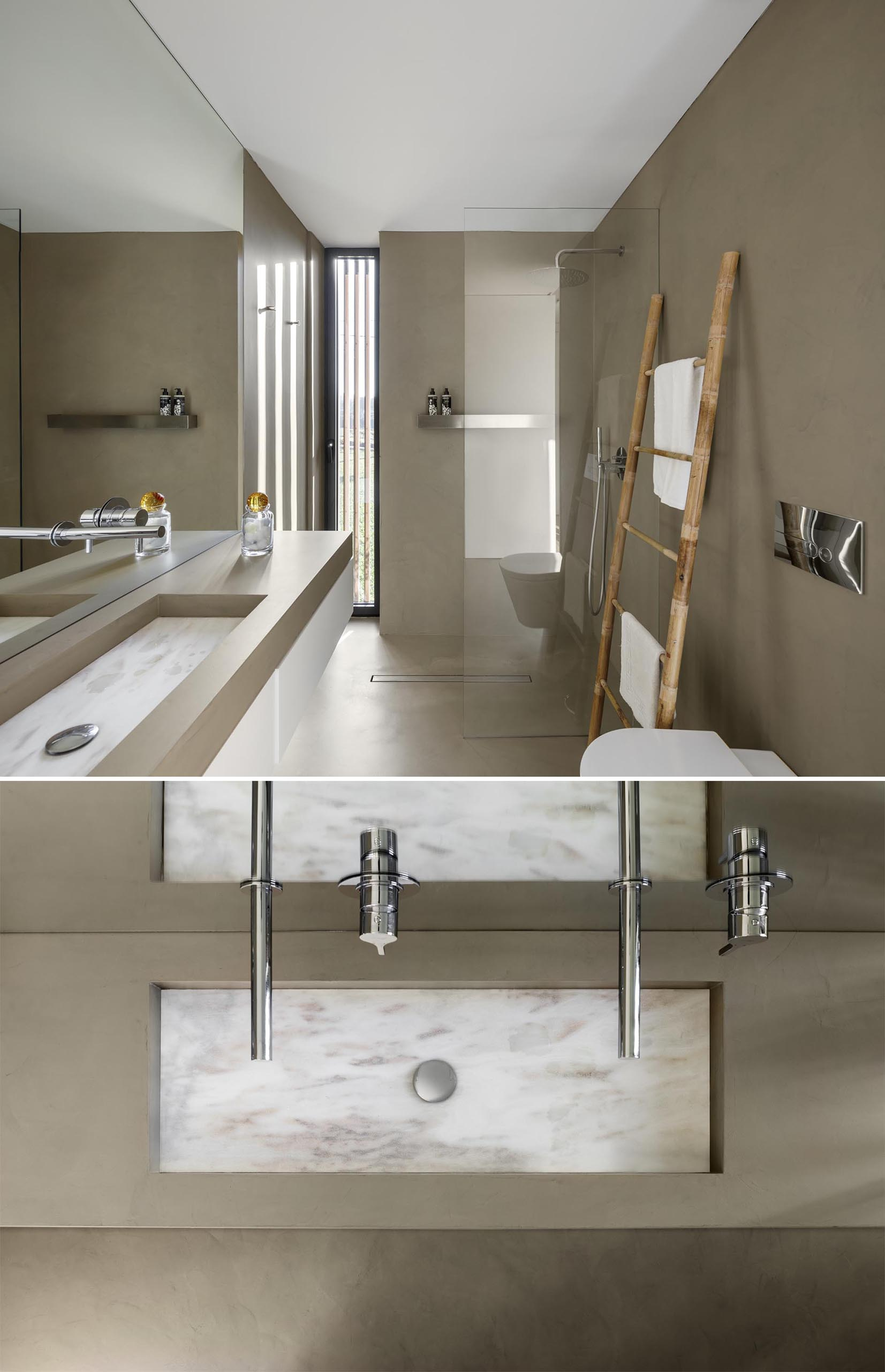 A modern bathroom with tan walls and a floating vanity with a built-in sink.