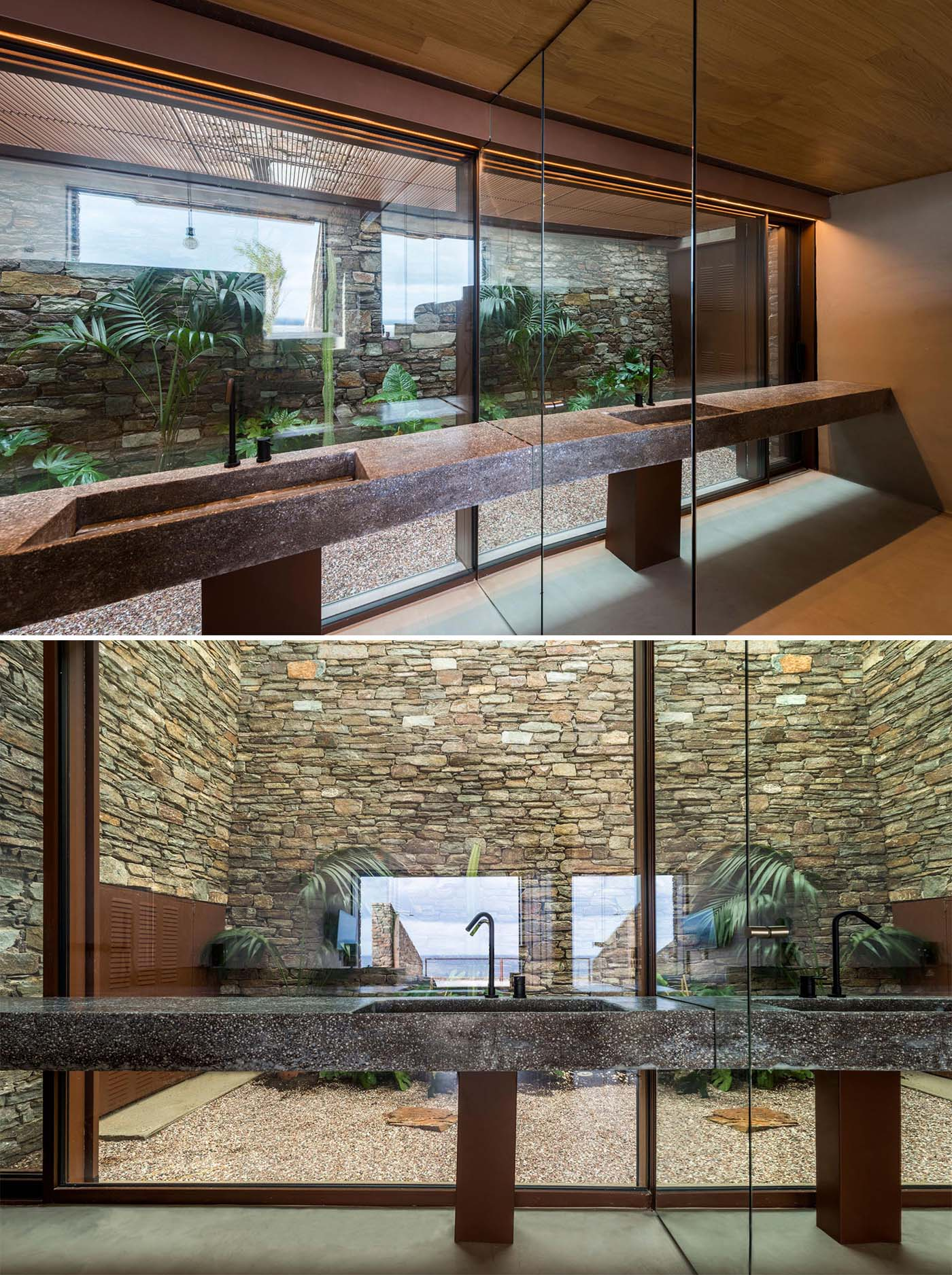 In this bathroom, a glass wall provides a view of a garden and stone wall.