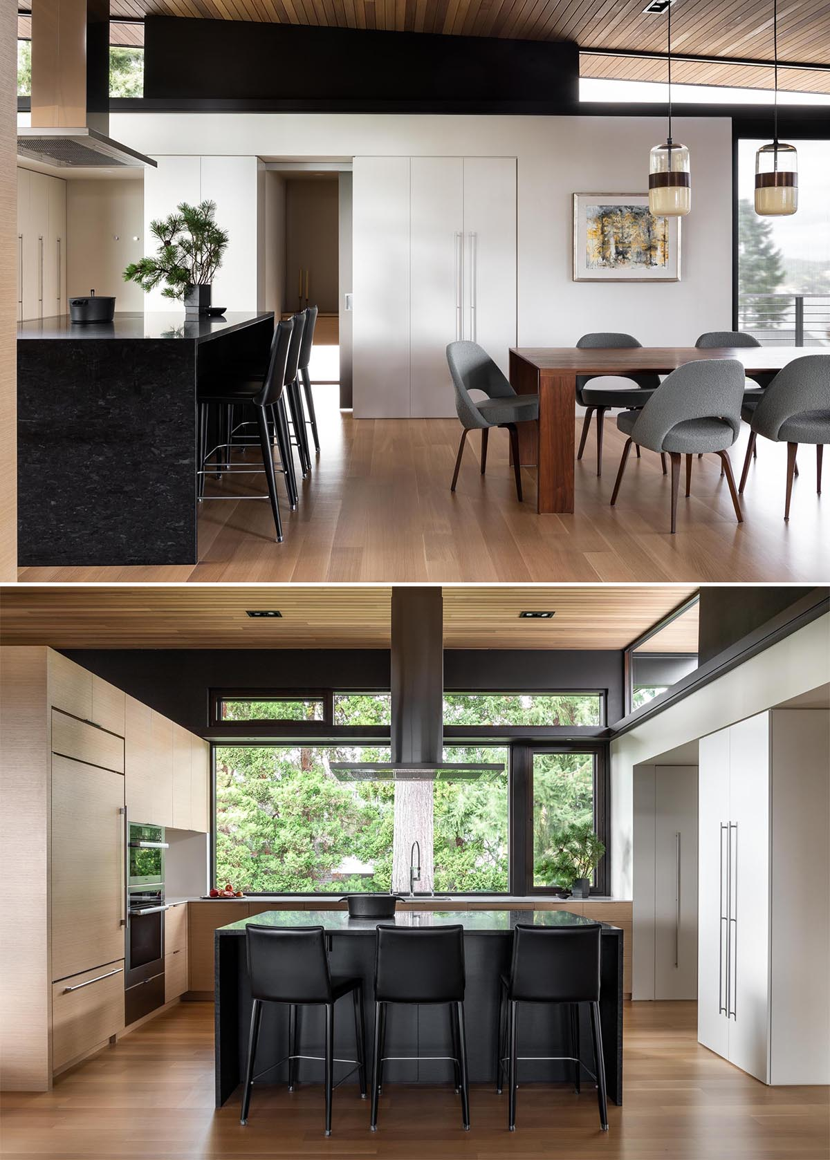 A modern kitchen with wood and white cabinets, and a black island.