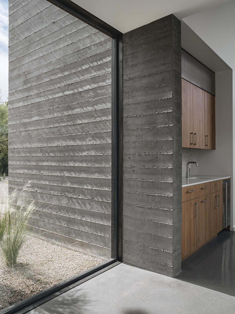 A modern home with board formed concrete walls.