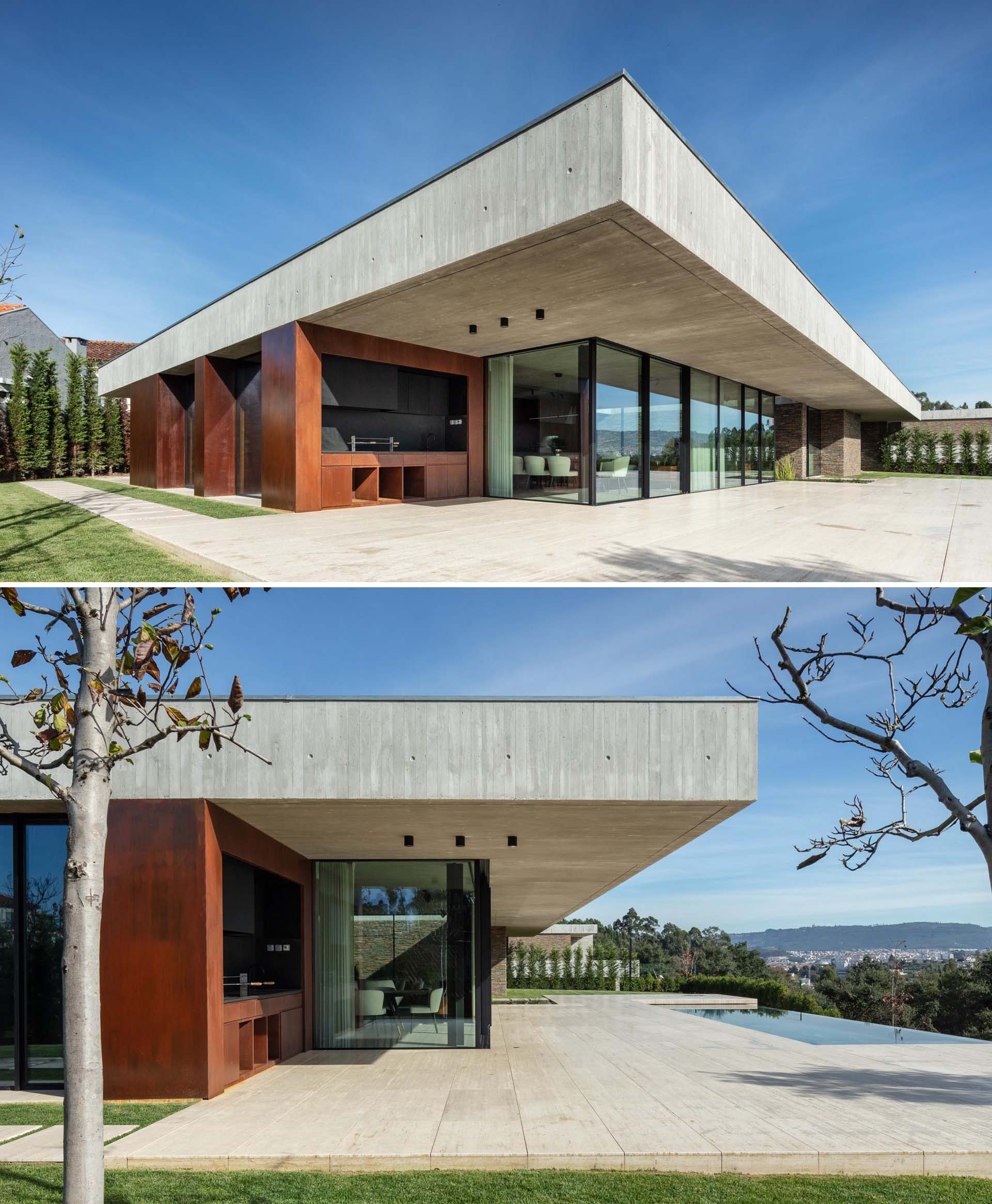 A modern concrete home with glass walls, an expansive patio, and a swimming pool.