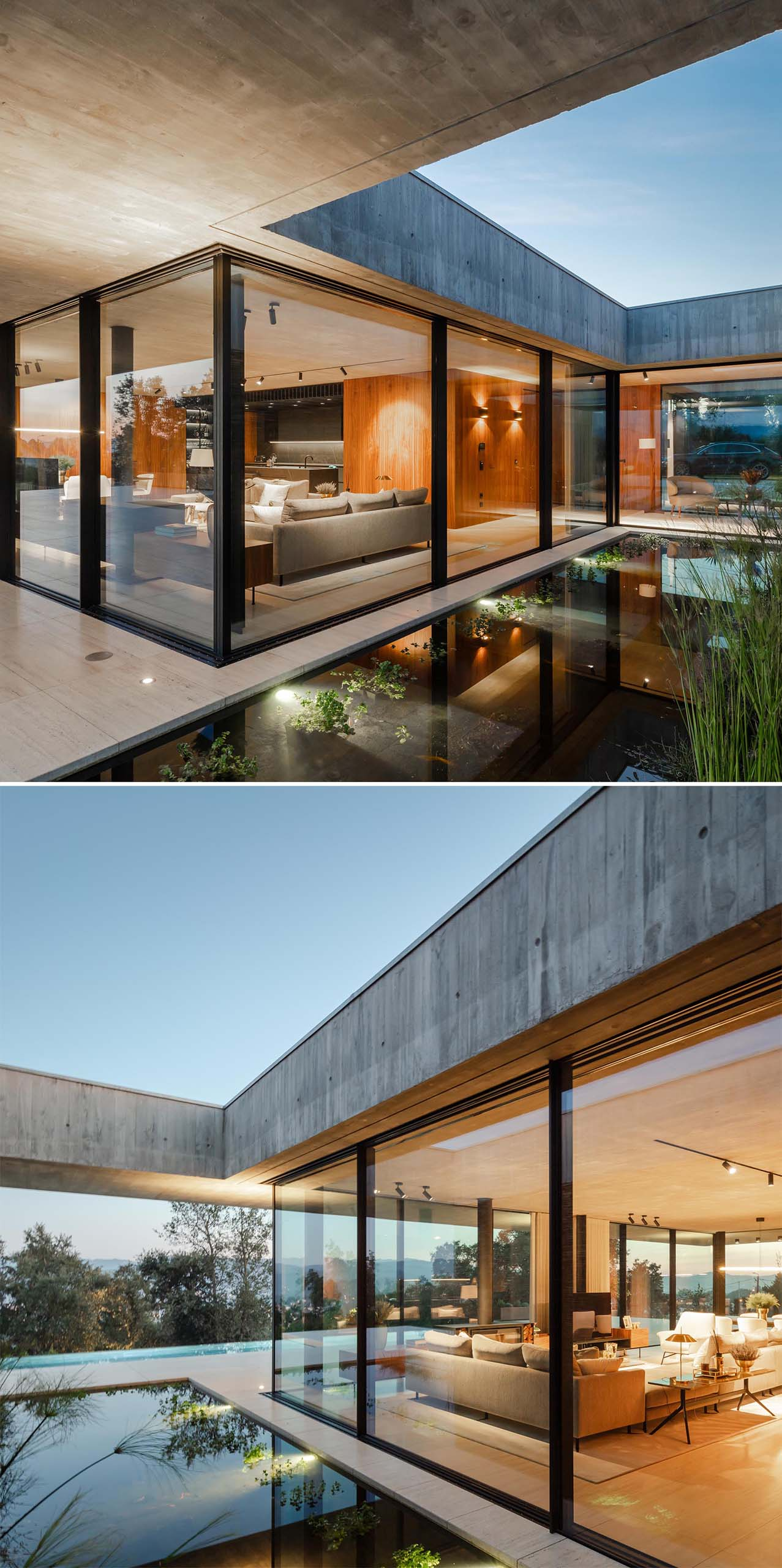 A modern concrete home with glass walls and a water feature.