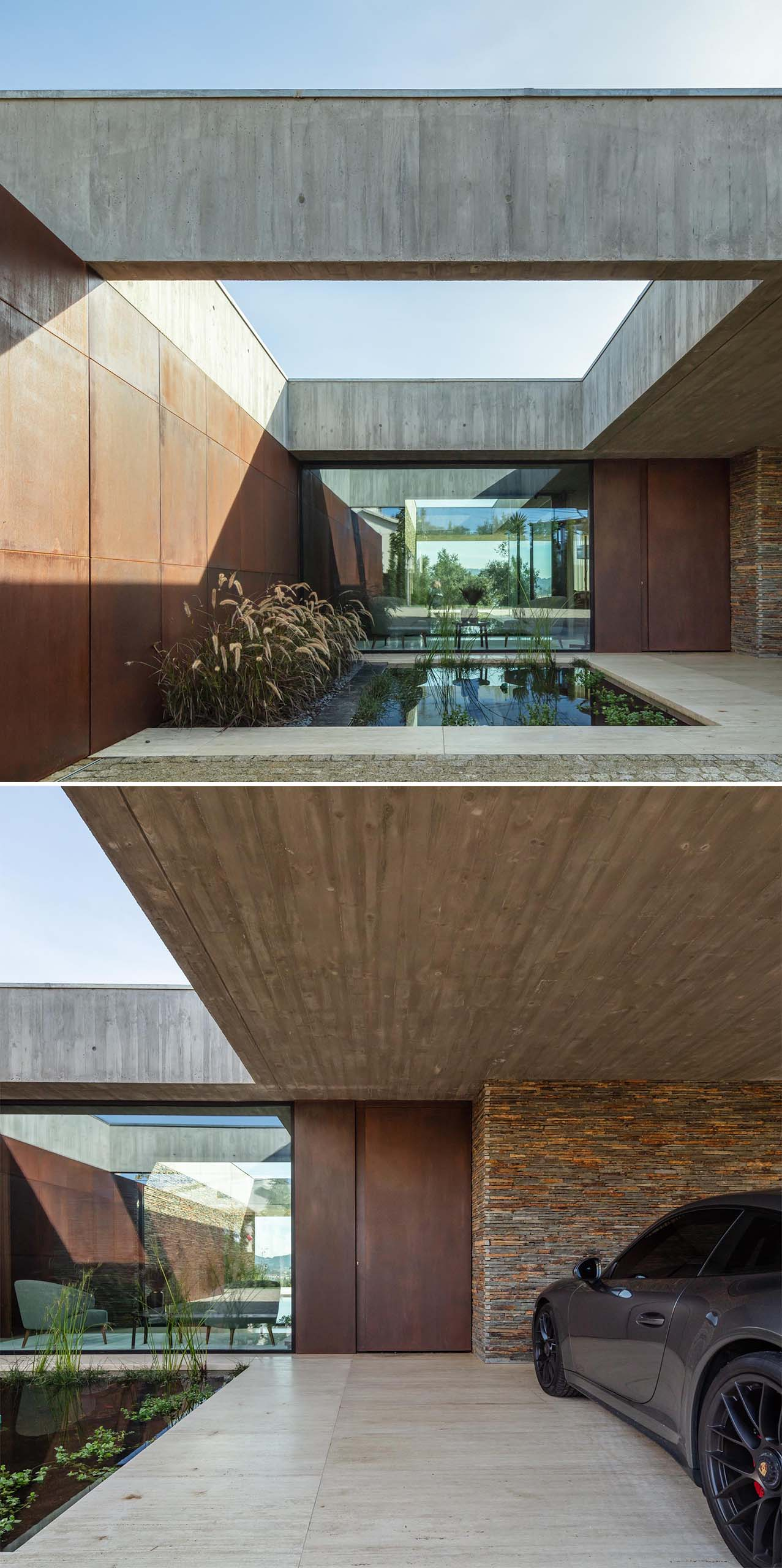 A modern concrete house with weathered steel and slate stone accent walls, and a water feature with plants.