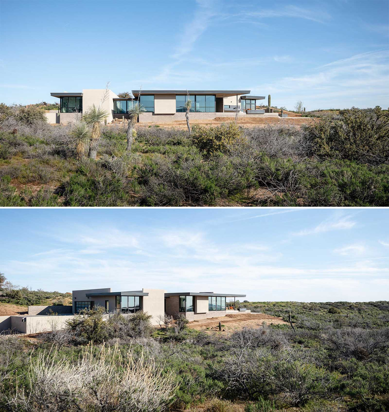 Surrounded by a desert landscape, this modern home has a large roof overhang that helps protect the glass areas from the harsh Arizona sun.