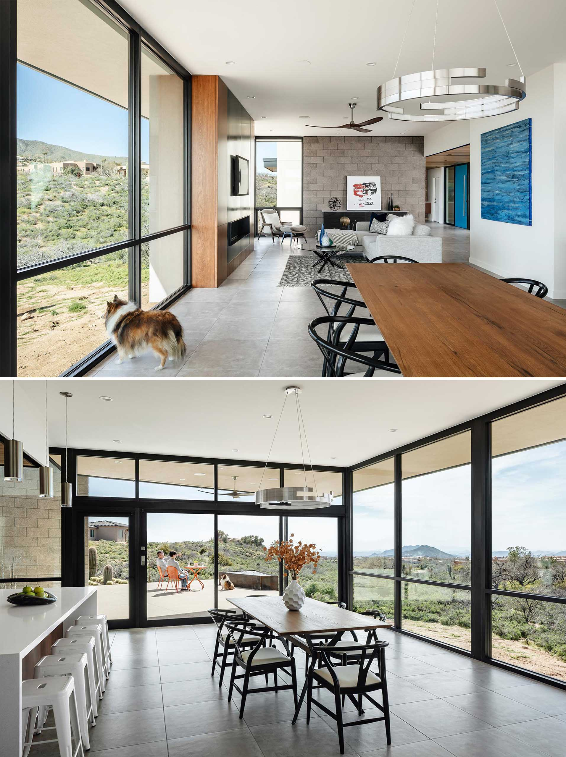 This modern dining area is surrounded by floor to ceiling glass, while a 3 panel sliding door systems opens to the outdoor patio beyond.