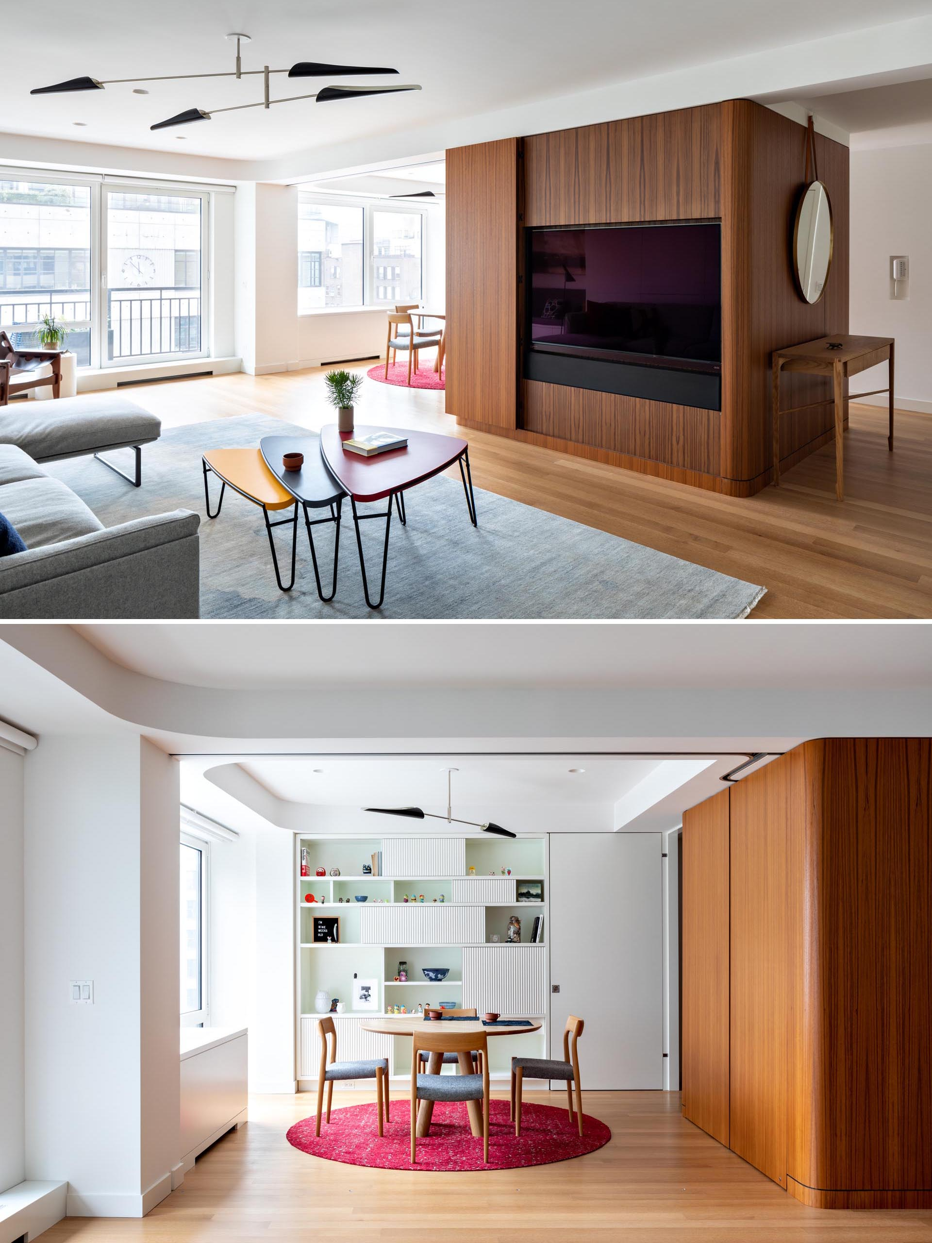 A modern apartment with teak panels that hide the TV, and a dining room with a white bookshelf.