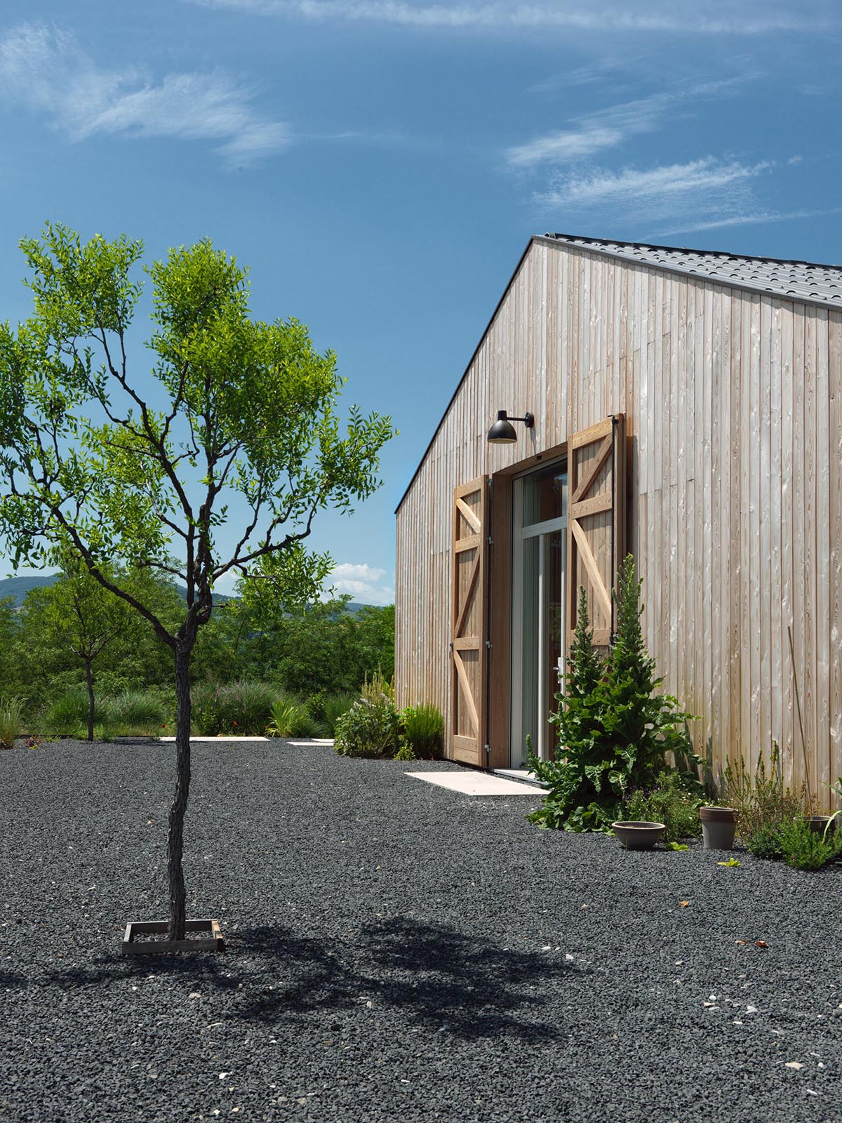 The exterior of this modern farmhouse is clad with natural larch wood.