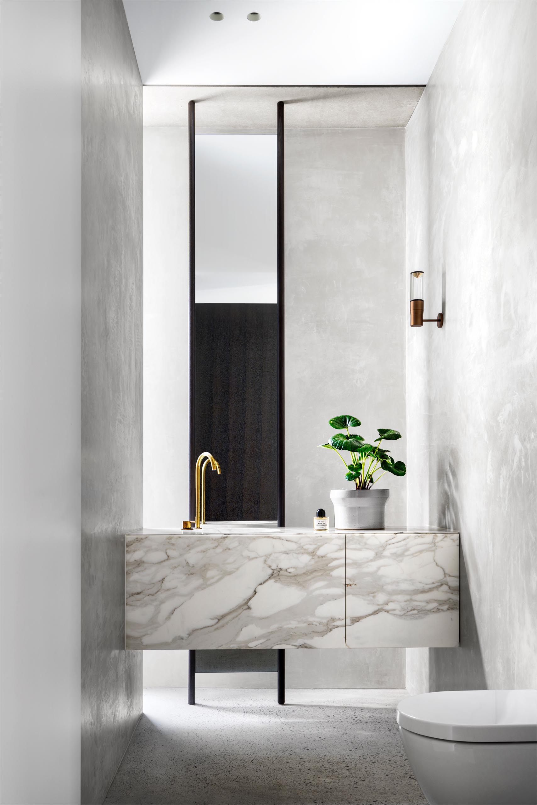 A modern bathroom with a marble vanity.