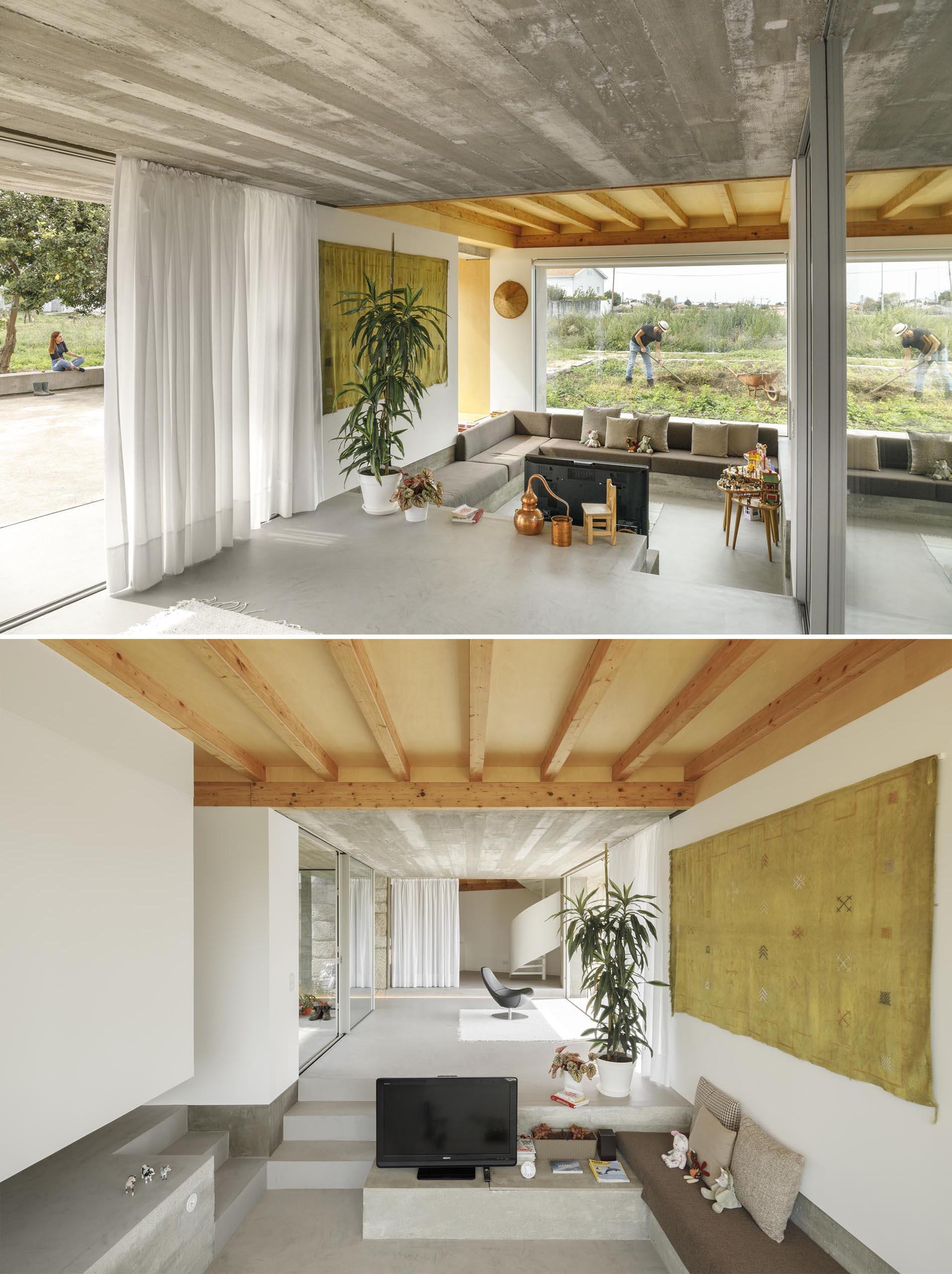 A sunken living room has a custom designed sofa.