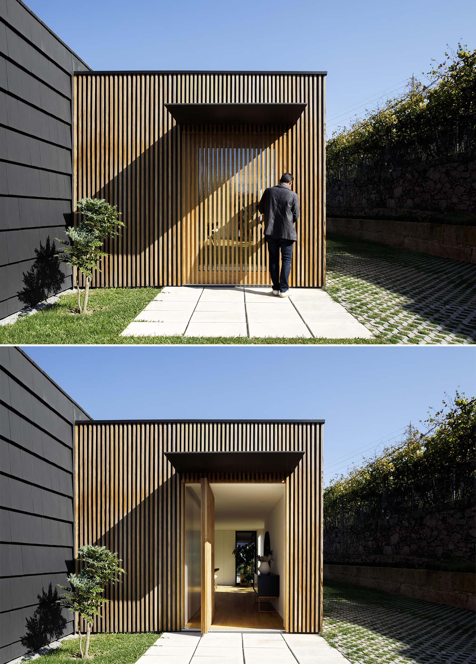 A modern home with a glass front door hidden from view with a wood slat wall.