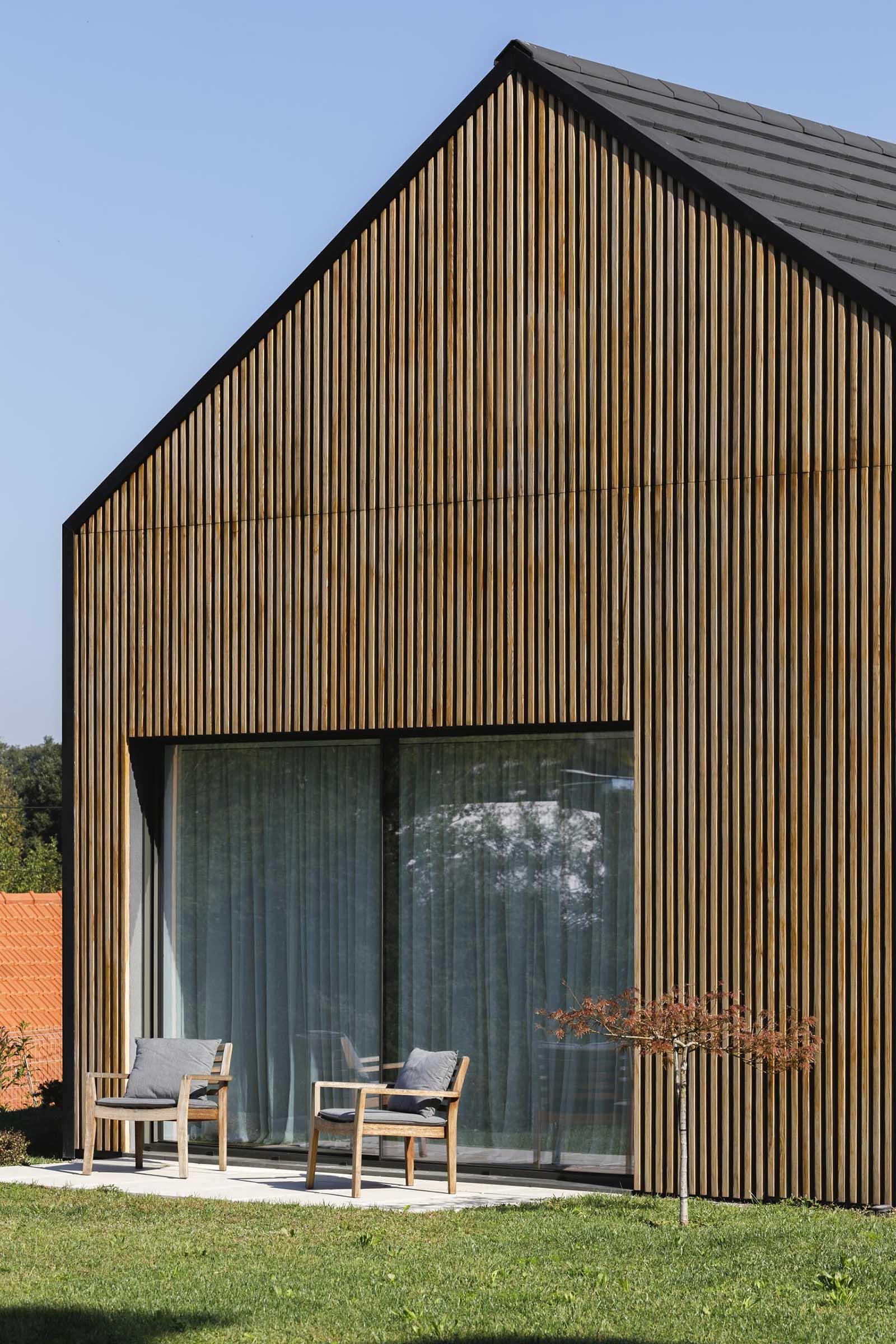 A modern house with a wood slat facade.