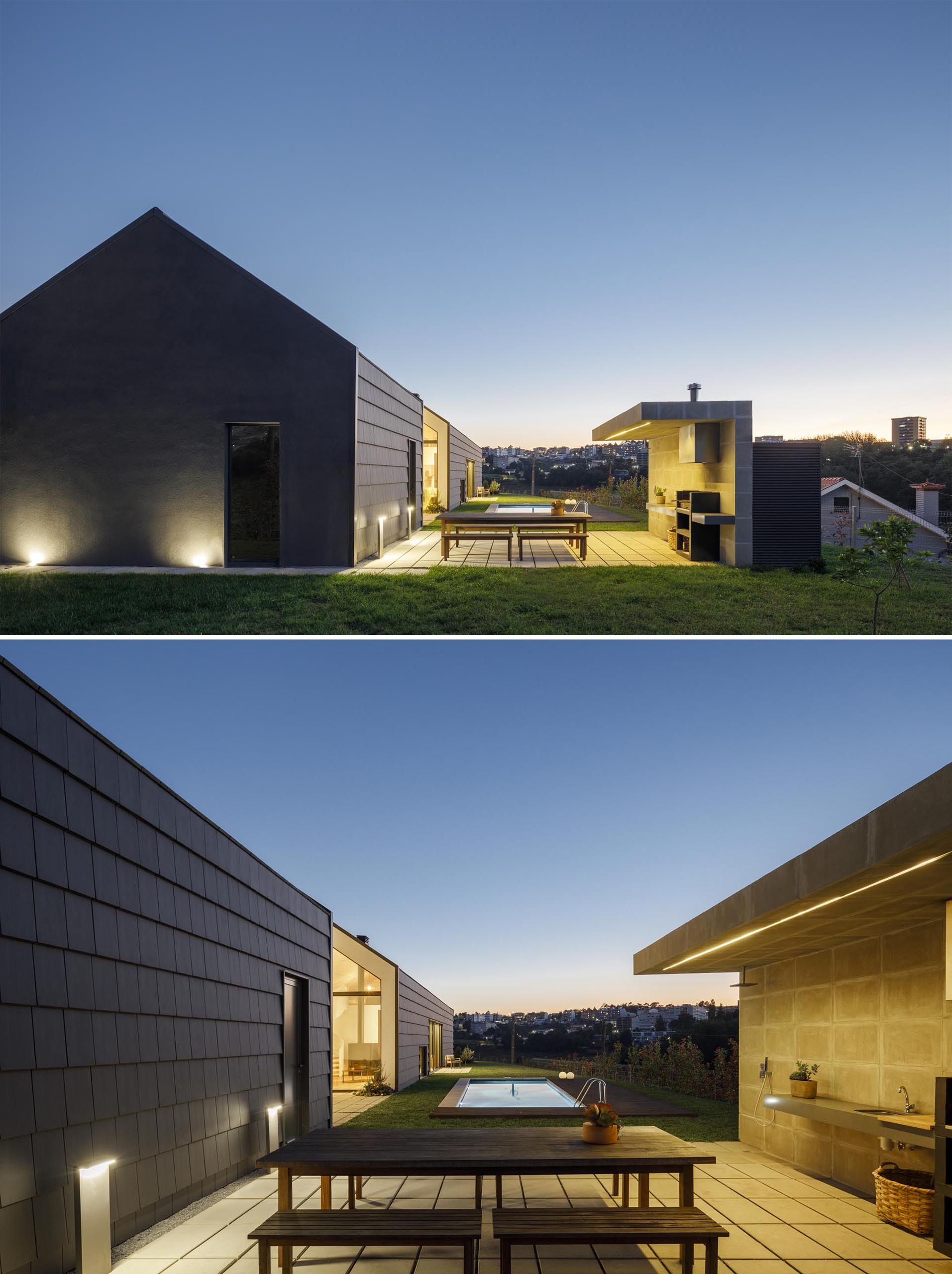 A modern house with a patio for outdoor dining and kitchen.