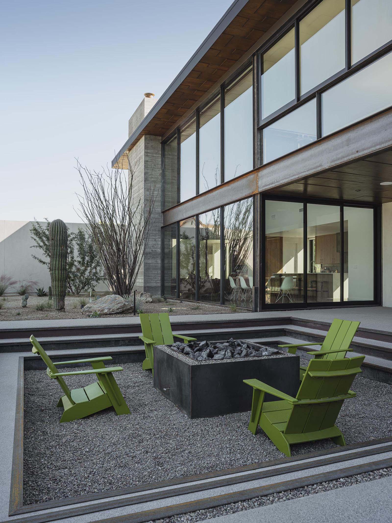 A modern desert home with a sunken fire pit.