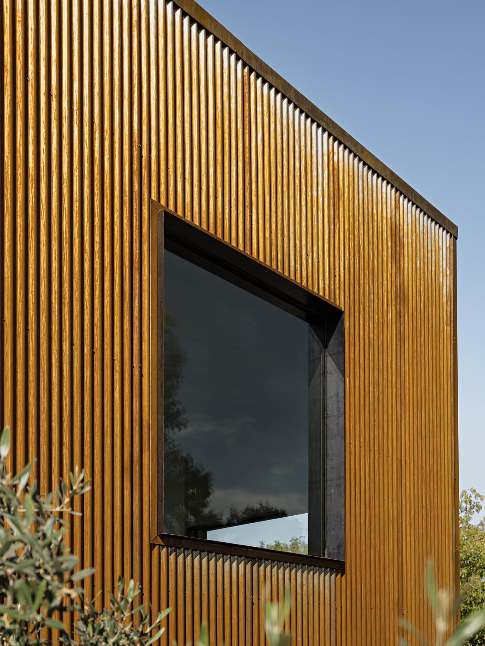 Weathered corrugated metal siding.