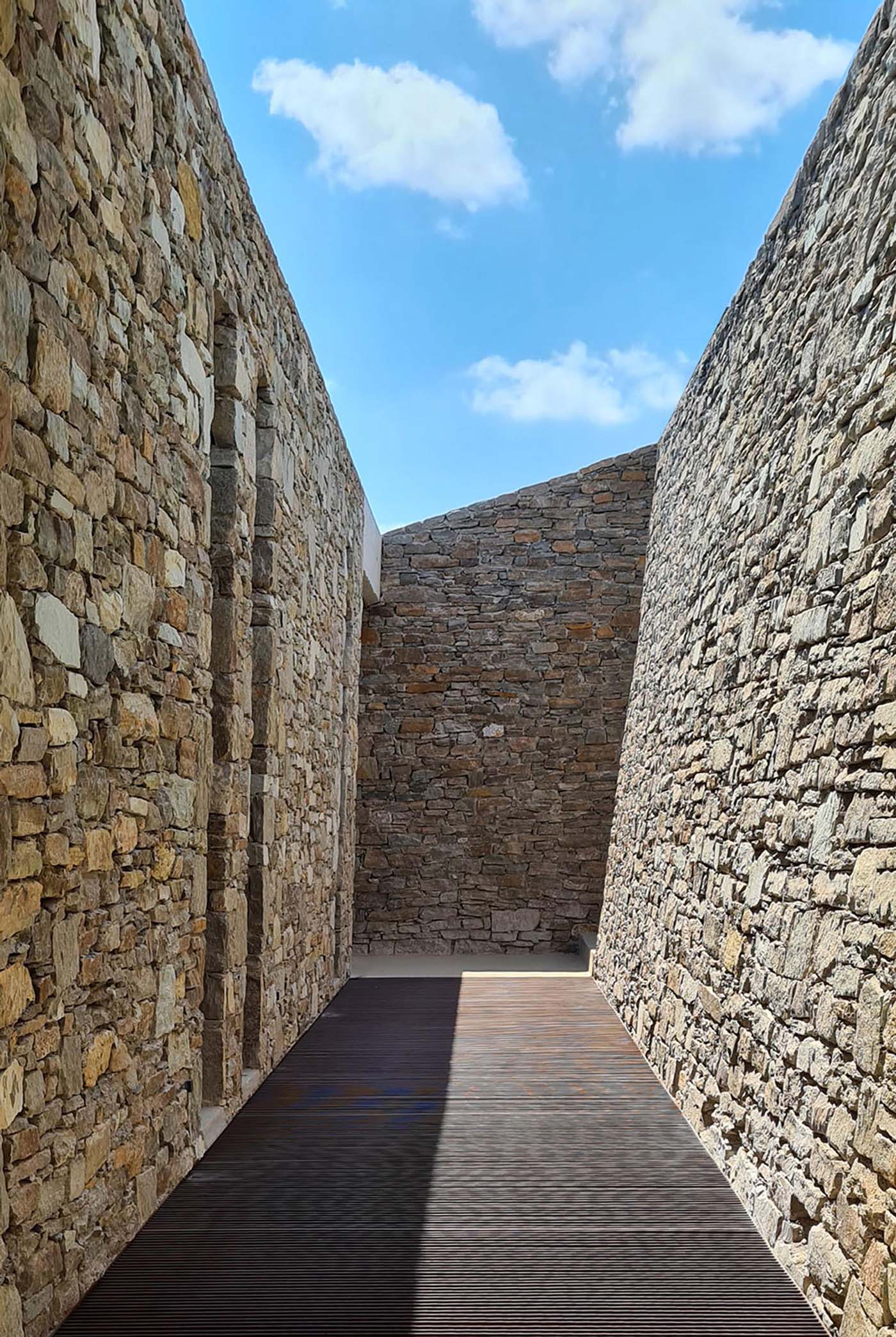 A modern home with an abundance of stone walls.