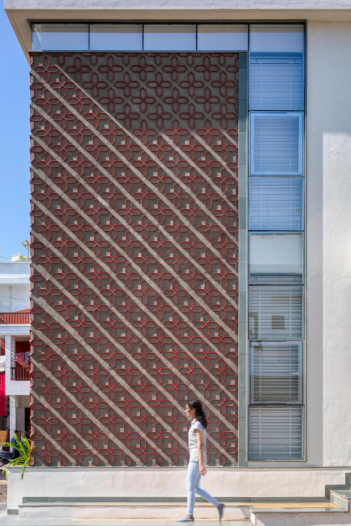 A unique patterned accent wall on a modern house facade.