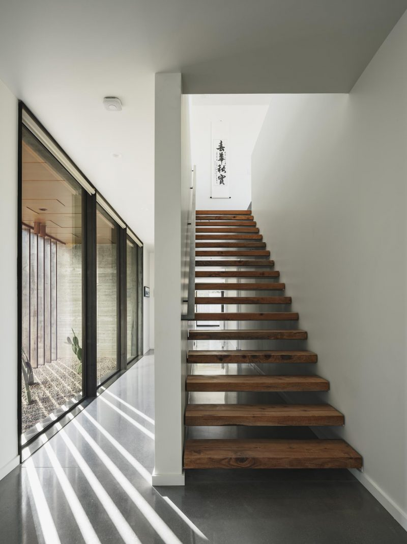 Wood stairs connect the lower level of the home with the upper floor.